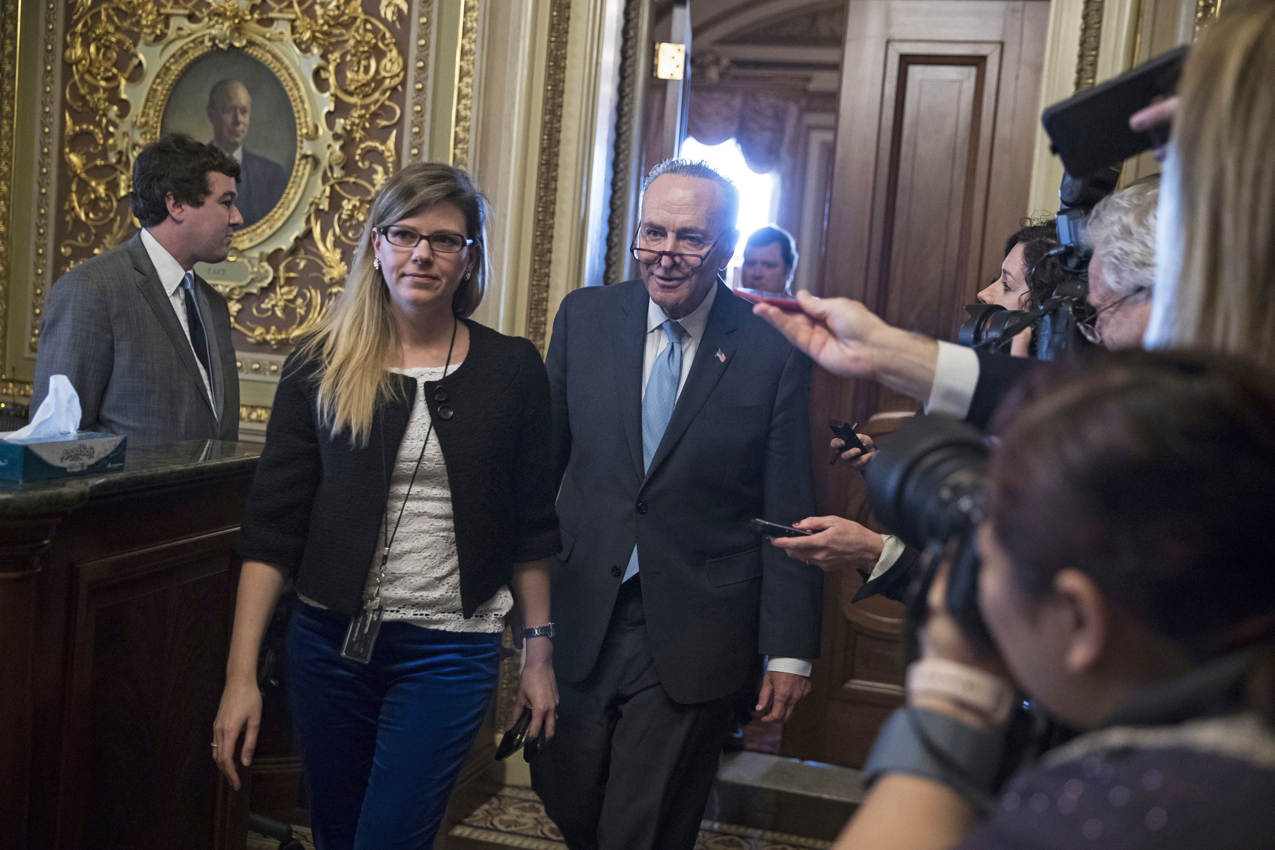 Liberals say Schumer caved to Trump, McConnell