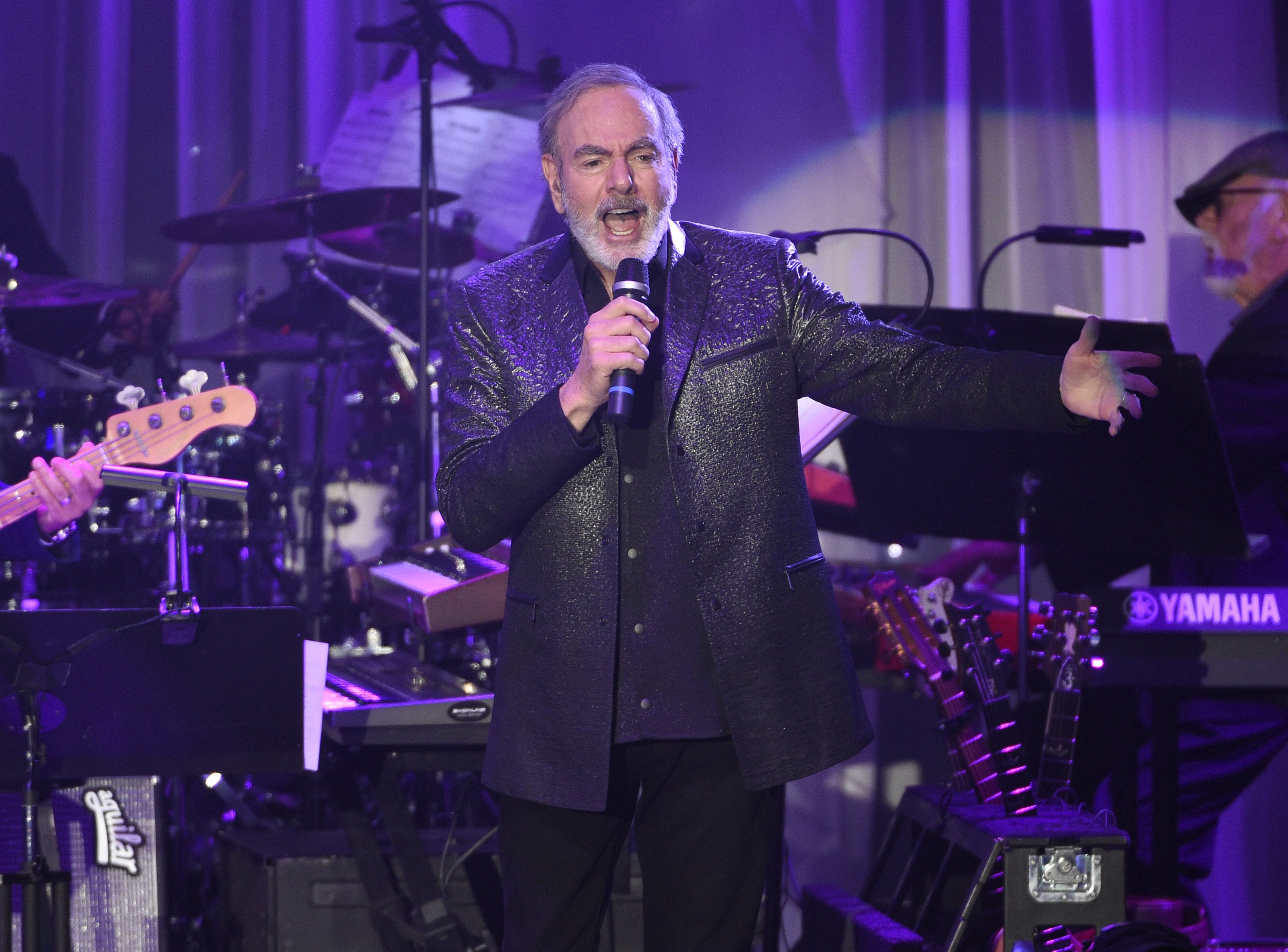 Neil Diamond retires from touring, citing Parkinson's