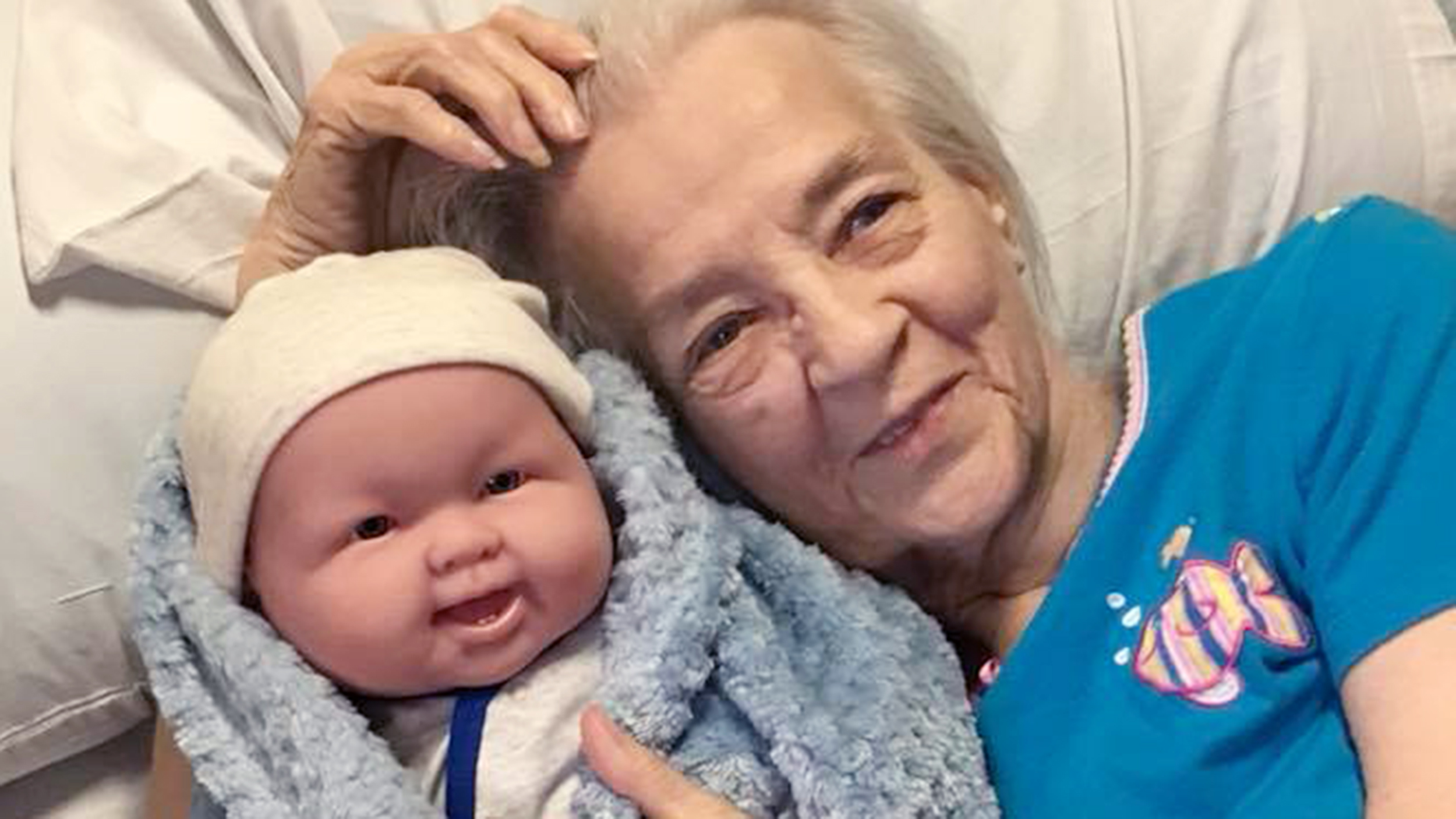 alzheimer s patients show joy when they receive baby dolls