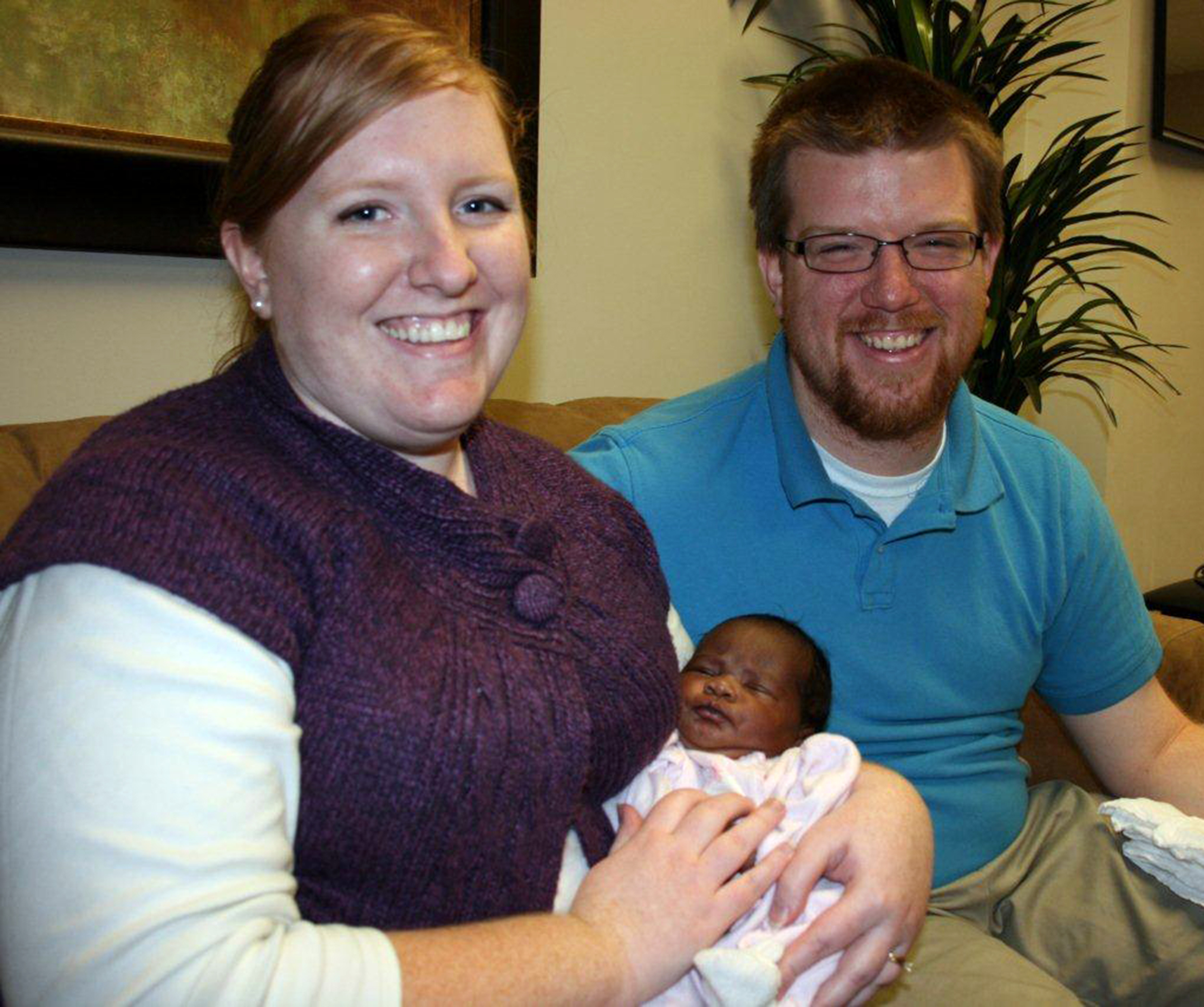Black white baby family Ariel Robinson