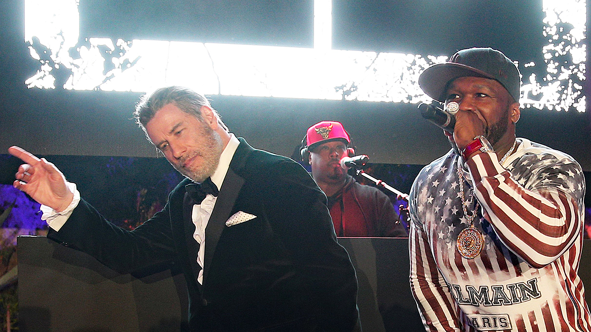 John Travolta shows ageless dance moves with 50 Cent at