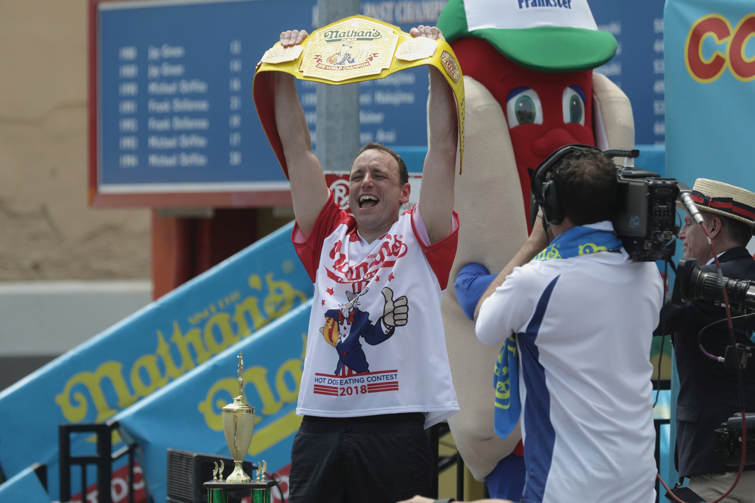 Joey Chestnut Downs A Record 74 Hot Dogs At Nathan S Famous