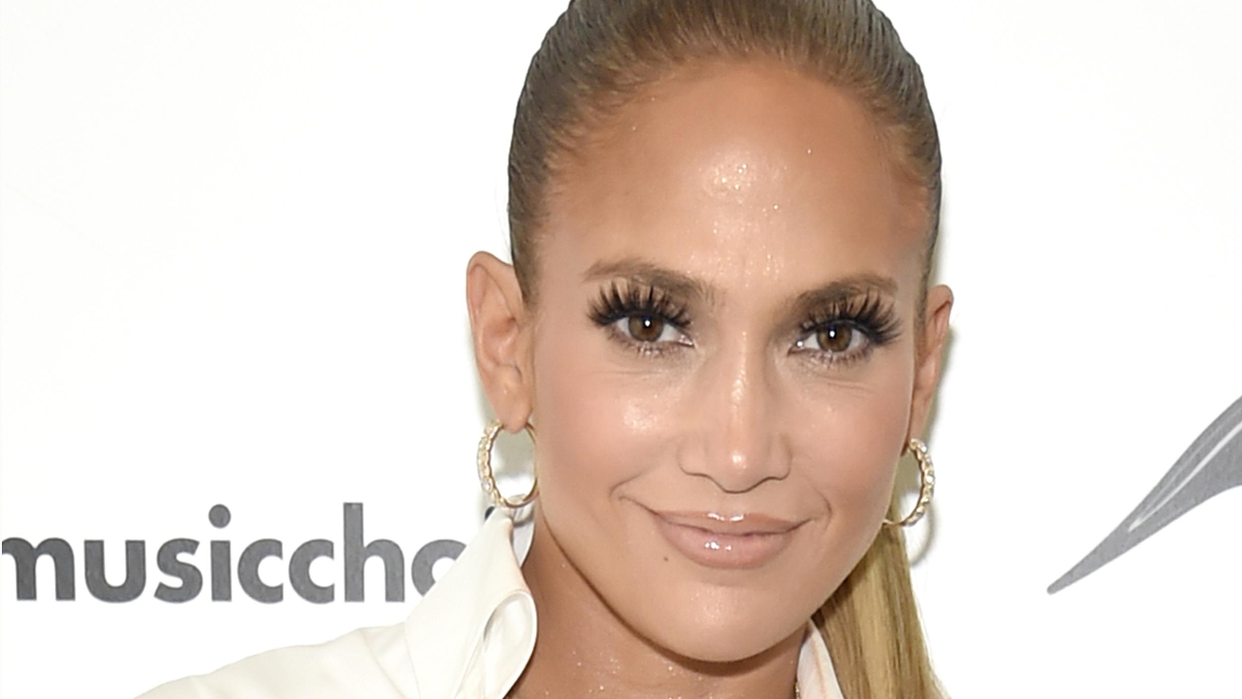 Jennifer Lopez Wears Versace Denim Boots