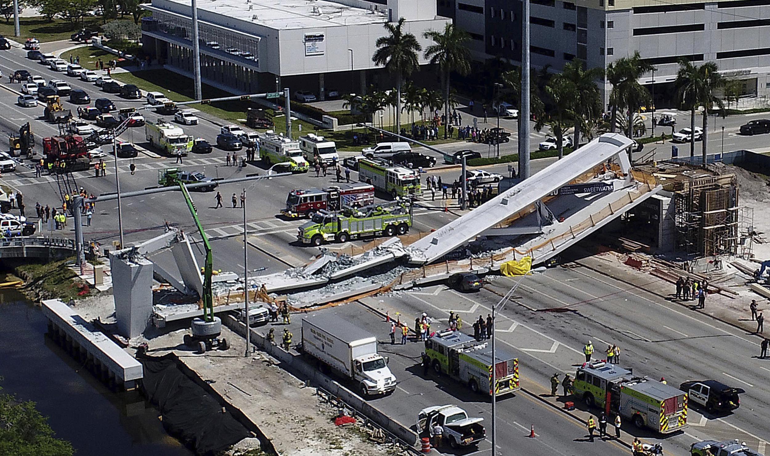 Miami pedestrian bridge collapses killing at least six officials say