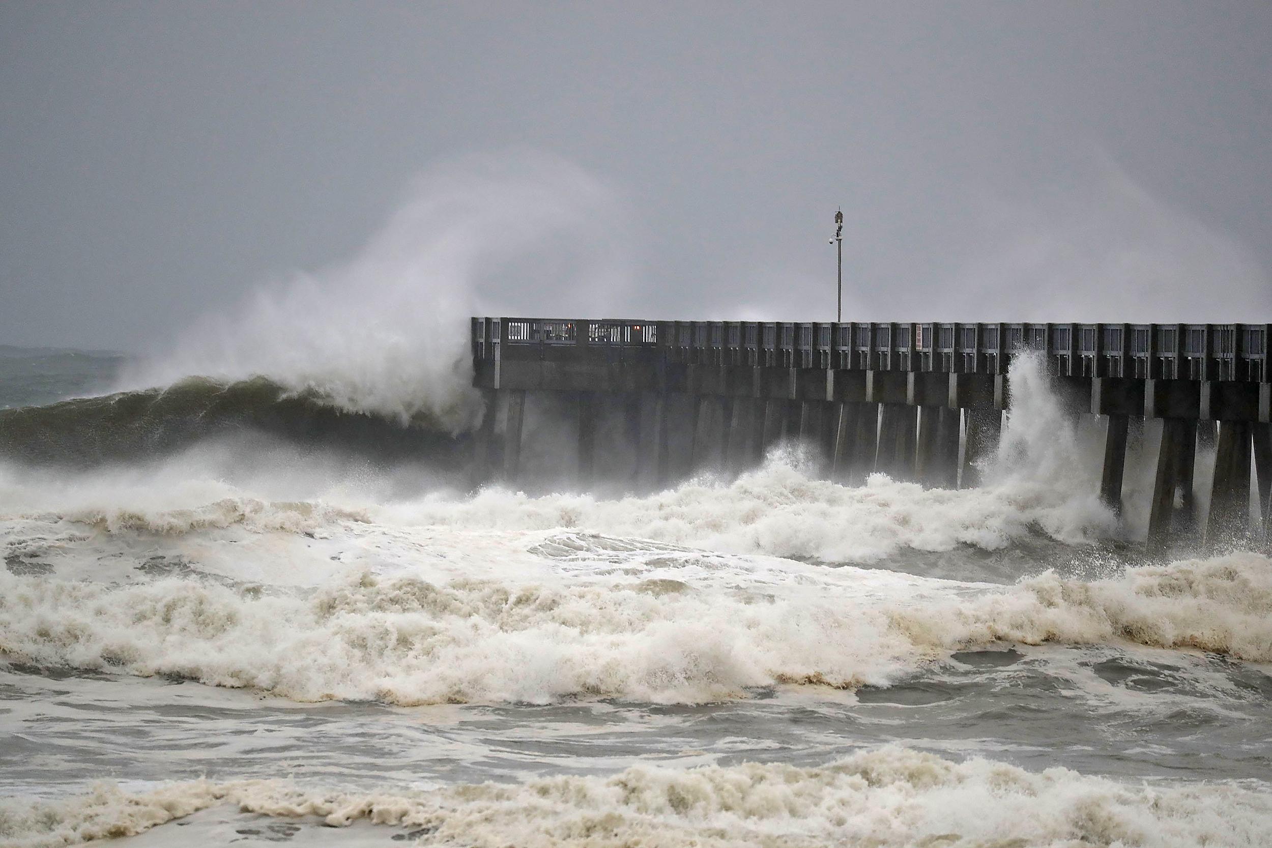Two dead as Michael, no longer a hurricane, churns across land