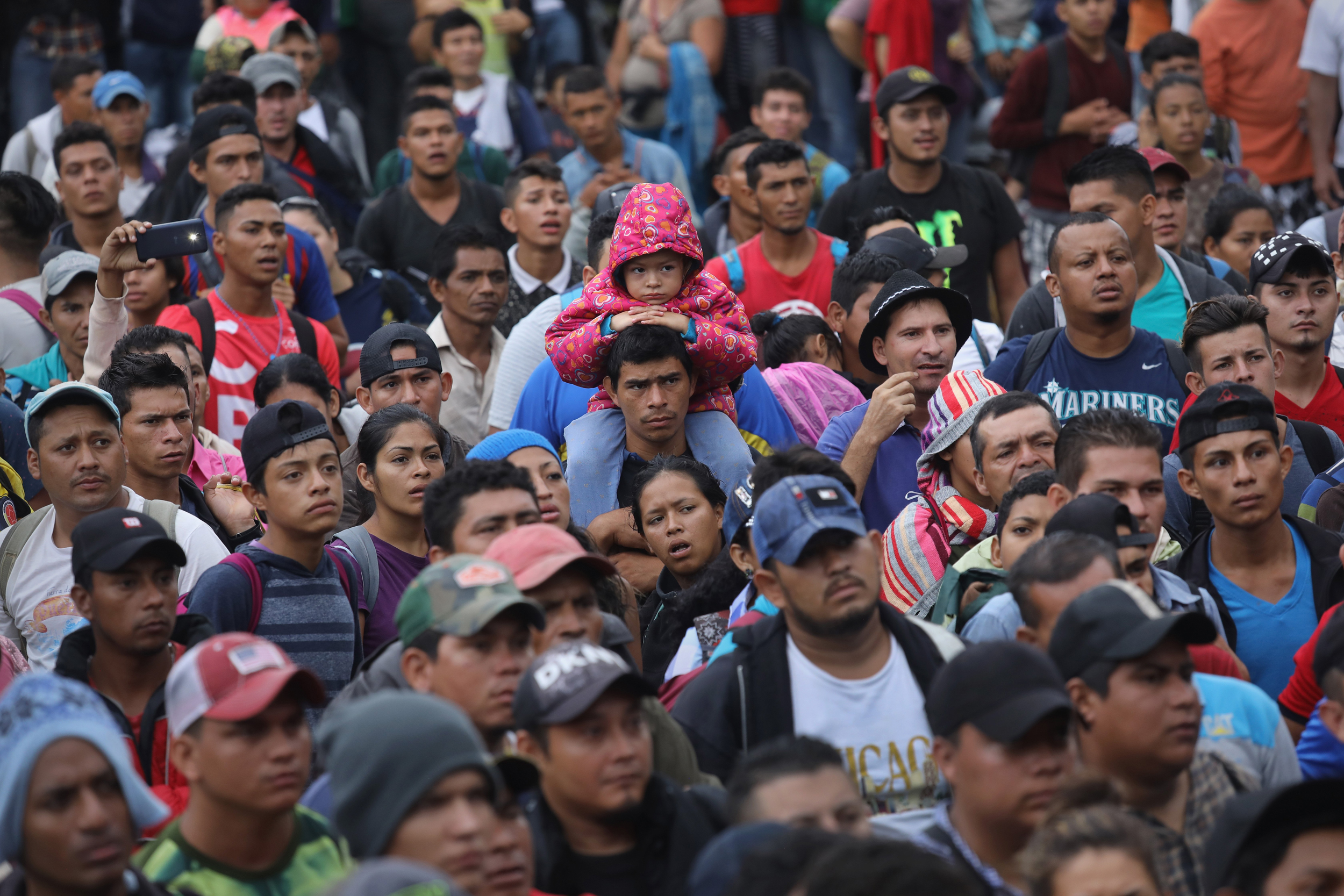 First Group From Honduran Caravan Crosses Into Mexico Testing President Trump S Red Line