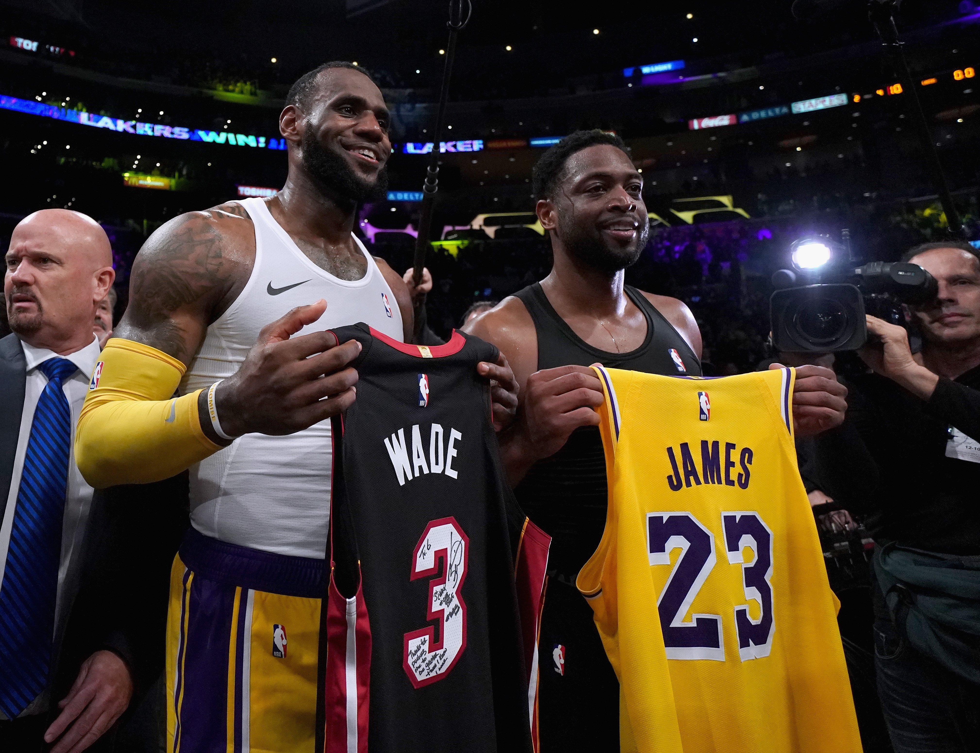 LeBron's Lakers edge Wade's Heat in superstars' final showdown