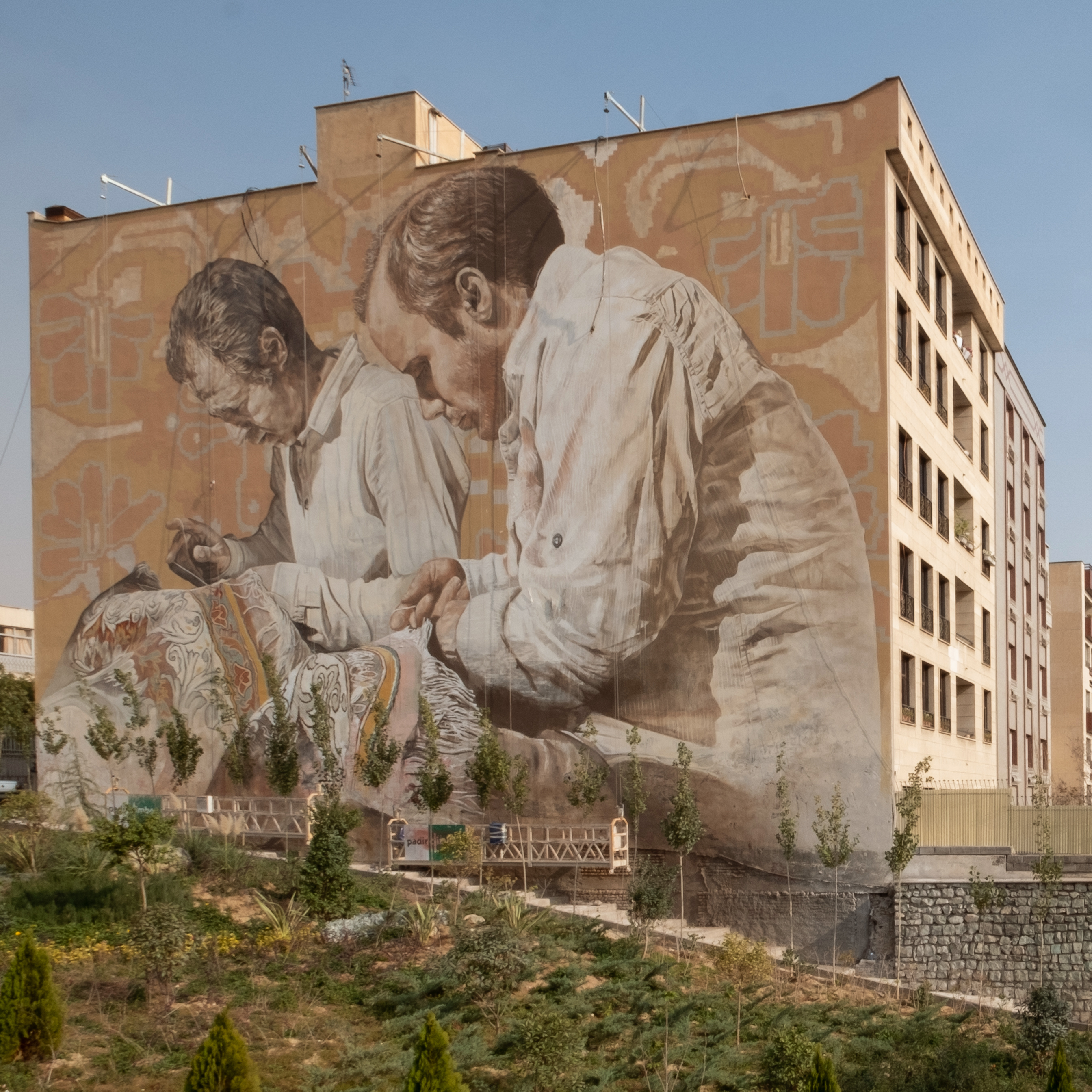 Western artists make history with six-story mural in Tehran