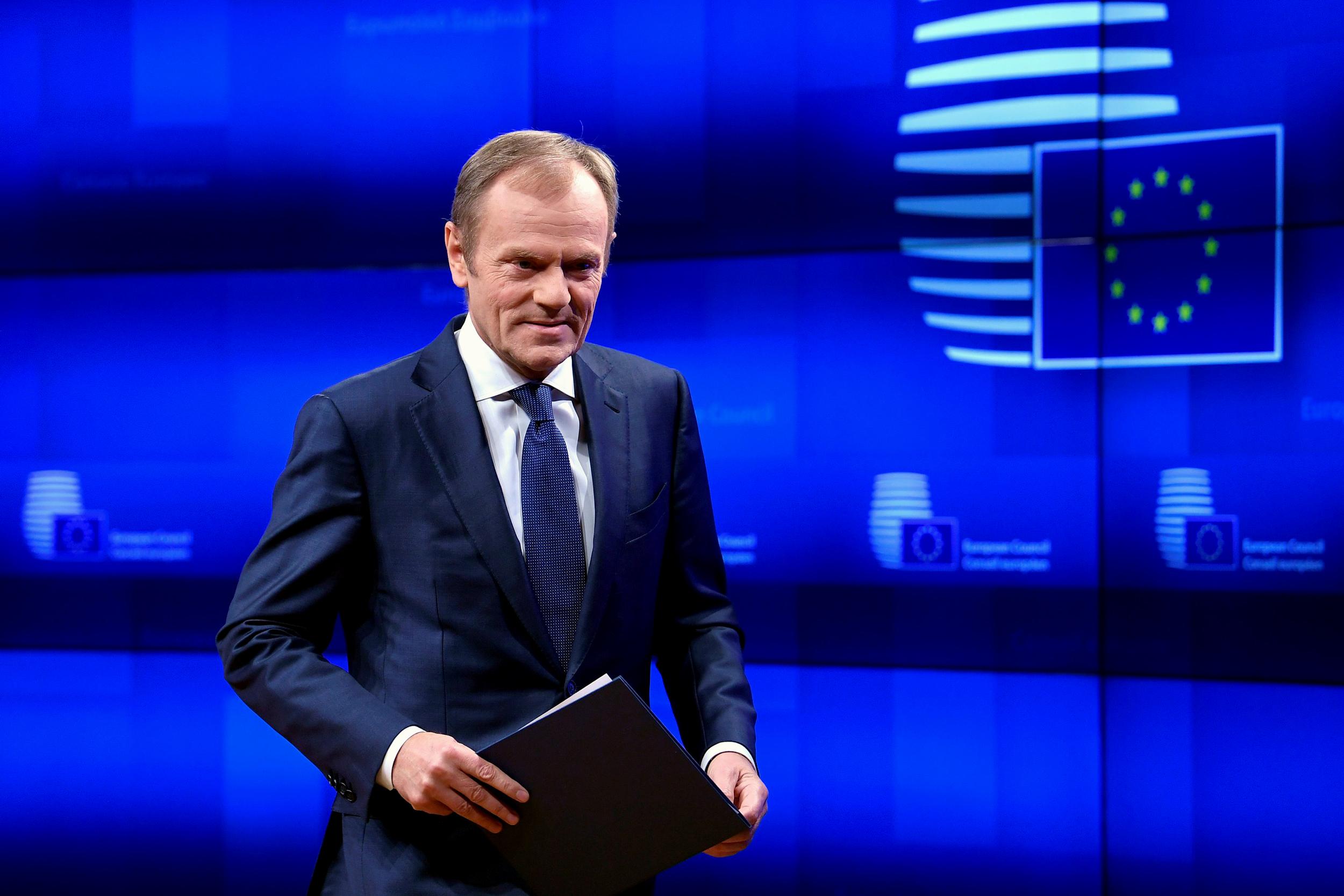 E.U. head Donald Tusk sees short Brexit delay if U.K. backs divorce deal