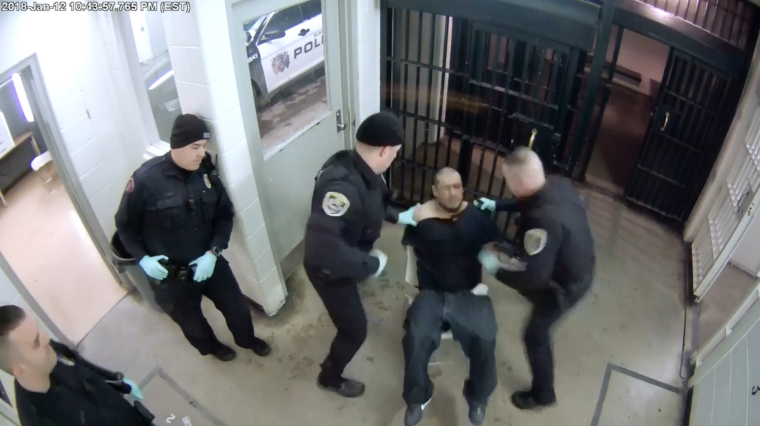 Two Indiana officers indicted for allegedly beating a handcuffed man