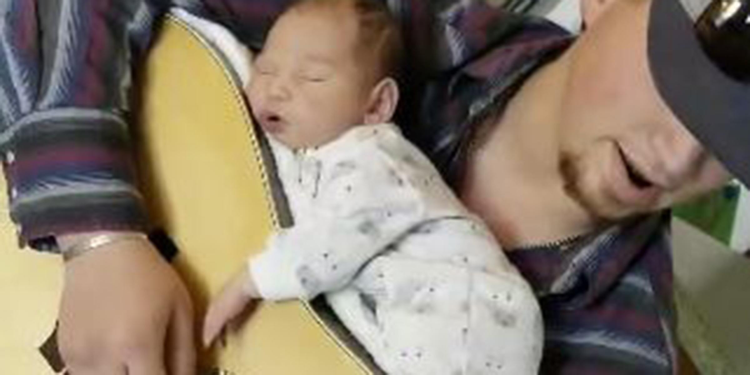 Flipboard: Newborn baby sleeps on top of dad's guitar while