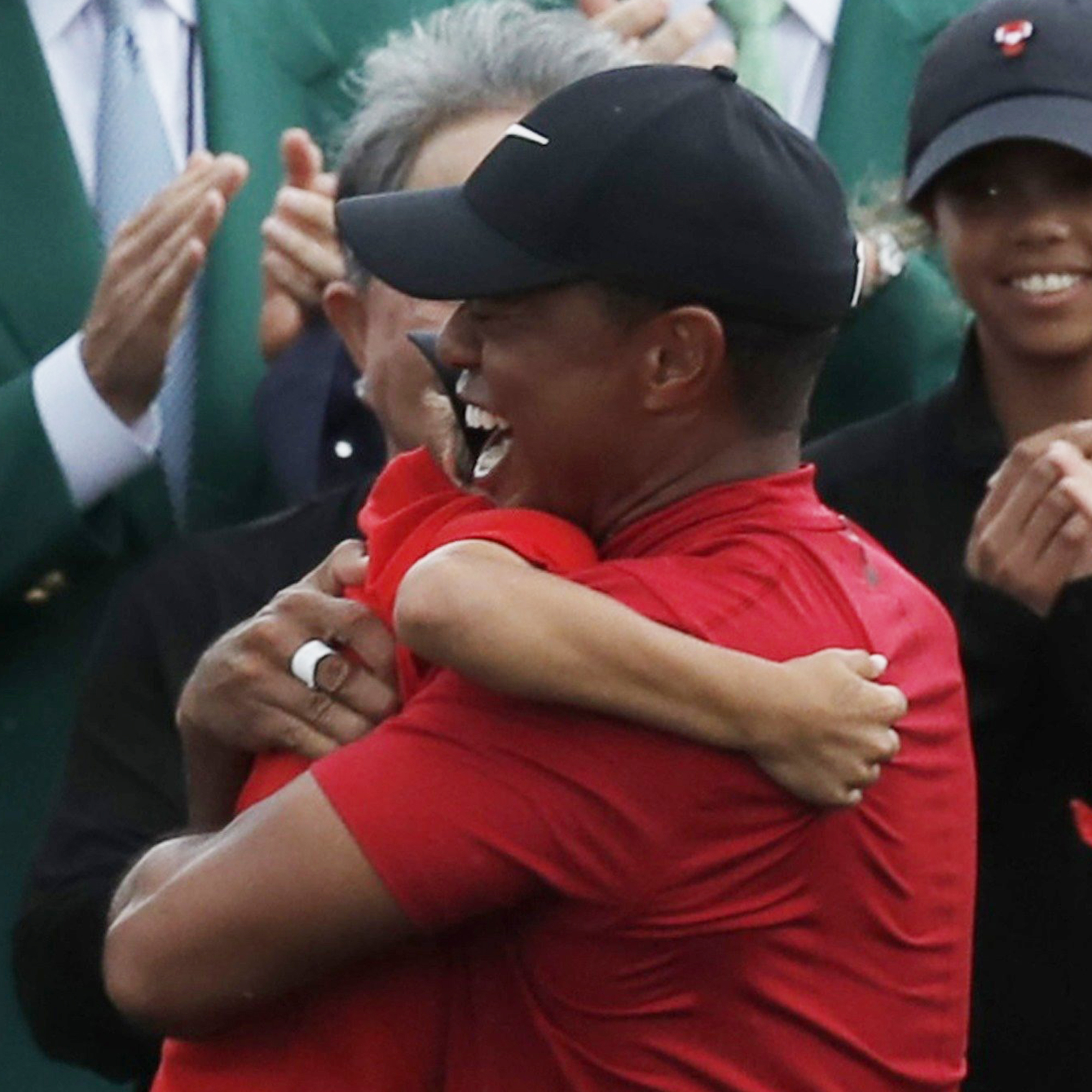 c7120e46 Tiger Woods embraces his kids after his 2019 Masters win in Augusta