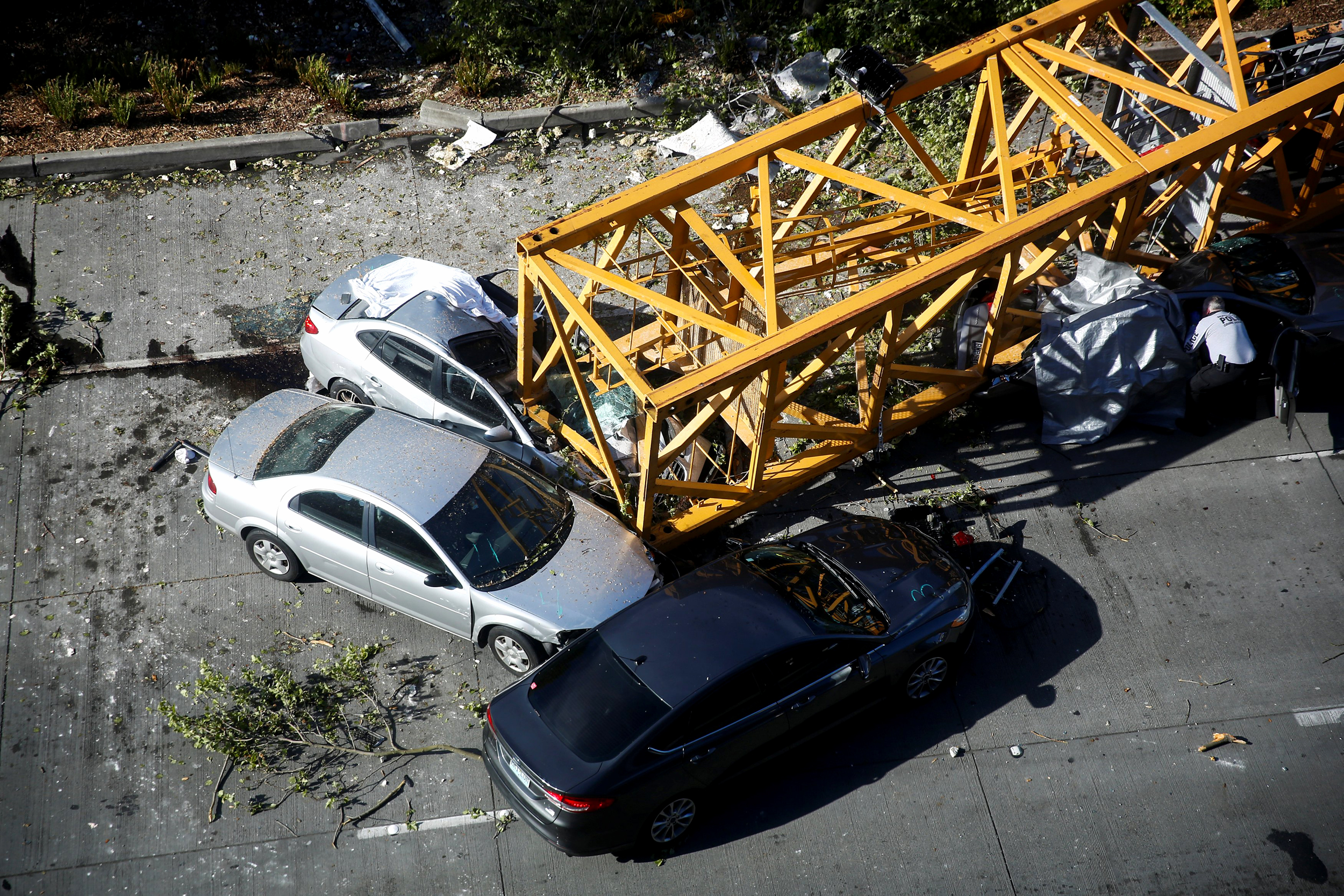 Crane collapses into Seattle traffic, killing 4