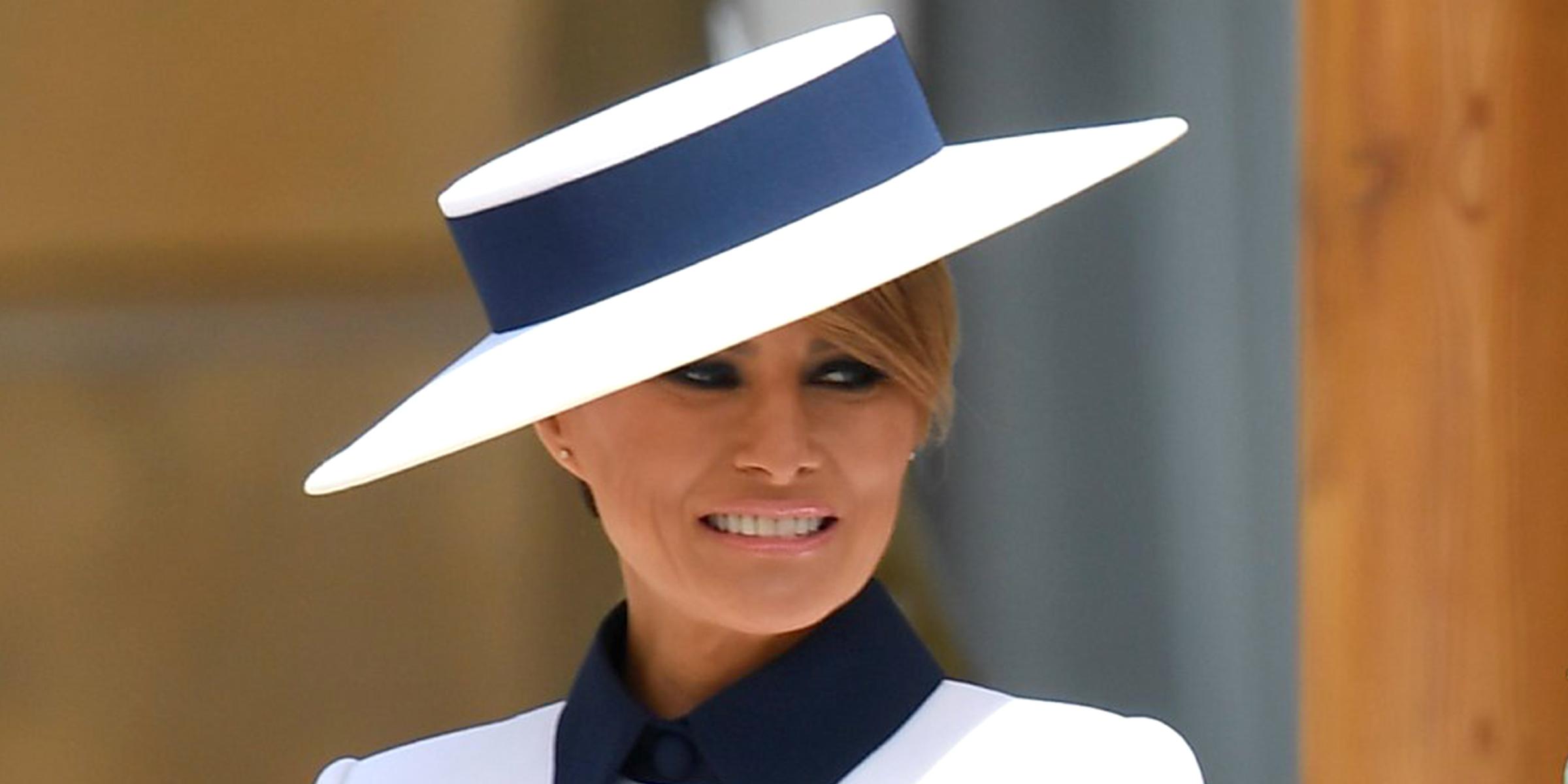 7d1965e9d Melania Trump wears navy blue-and-white 'My Fair Lady' ensemble to ...