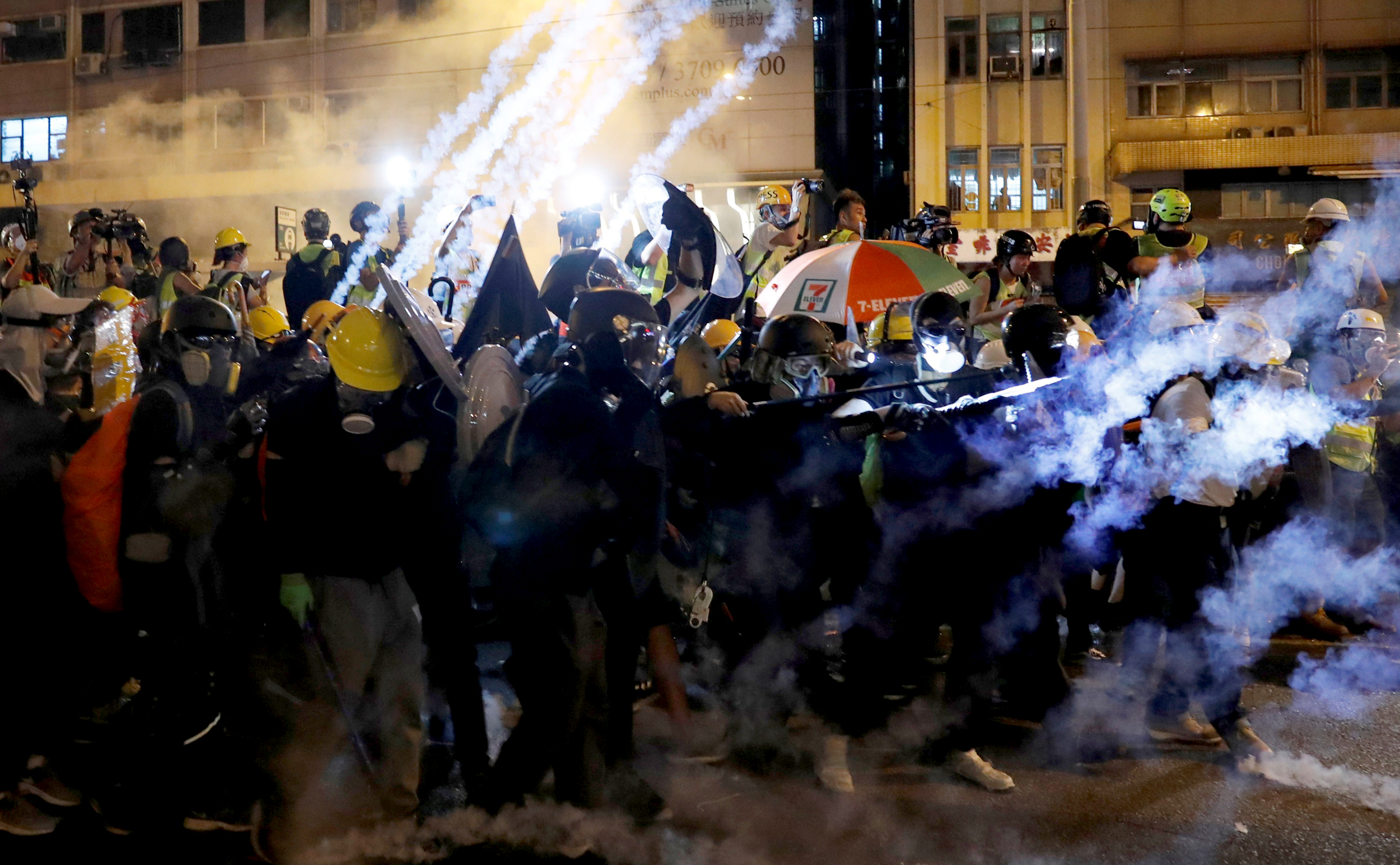 Protesters-attacked,-tear-gassed-as-Hong-Kong-protest-march-violent