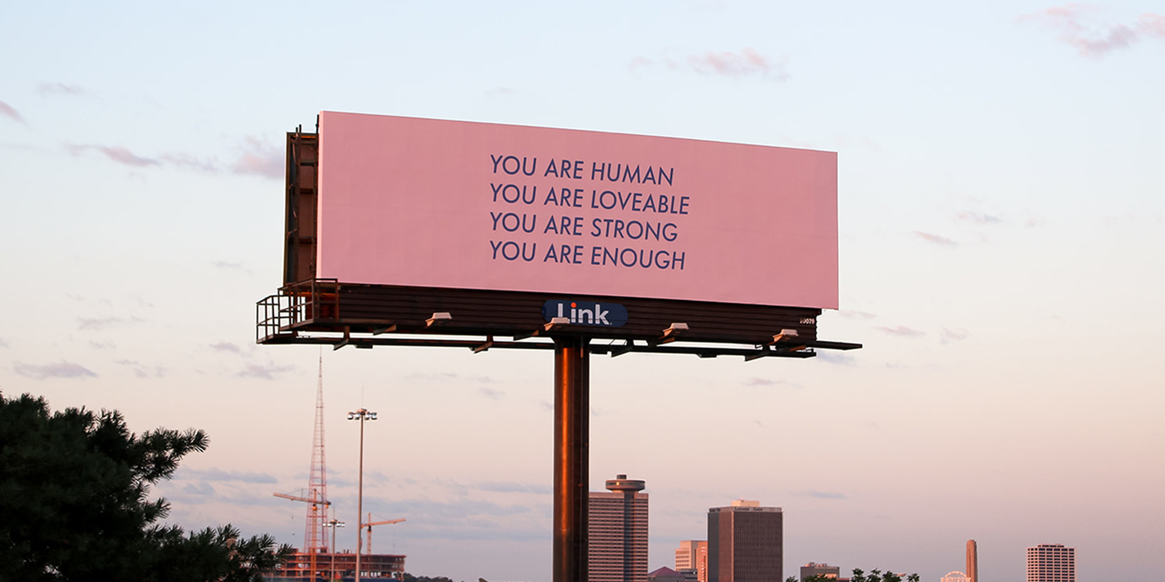 After losing her dad to suicide, woman uses a billboard to spread hope