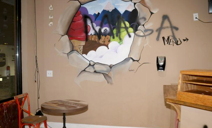 Image: Several graffiti words and symbols, including