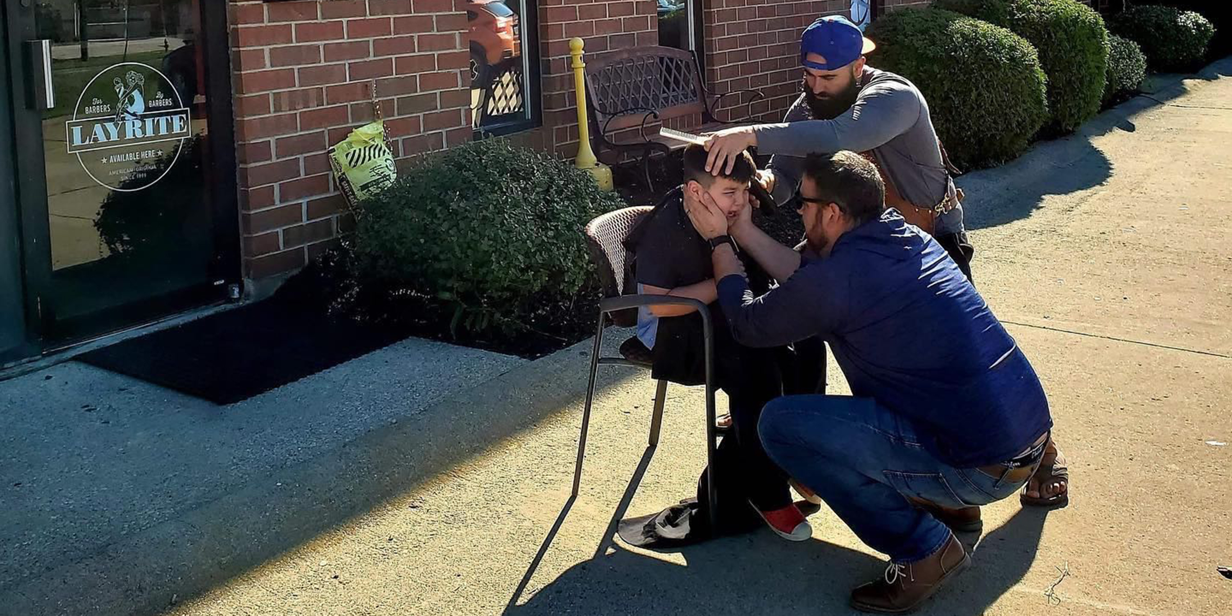 Barber moves chair outside for overwhelmed boy with autism