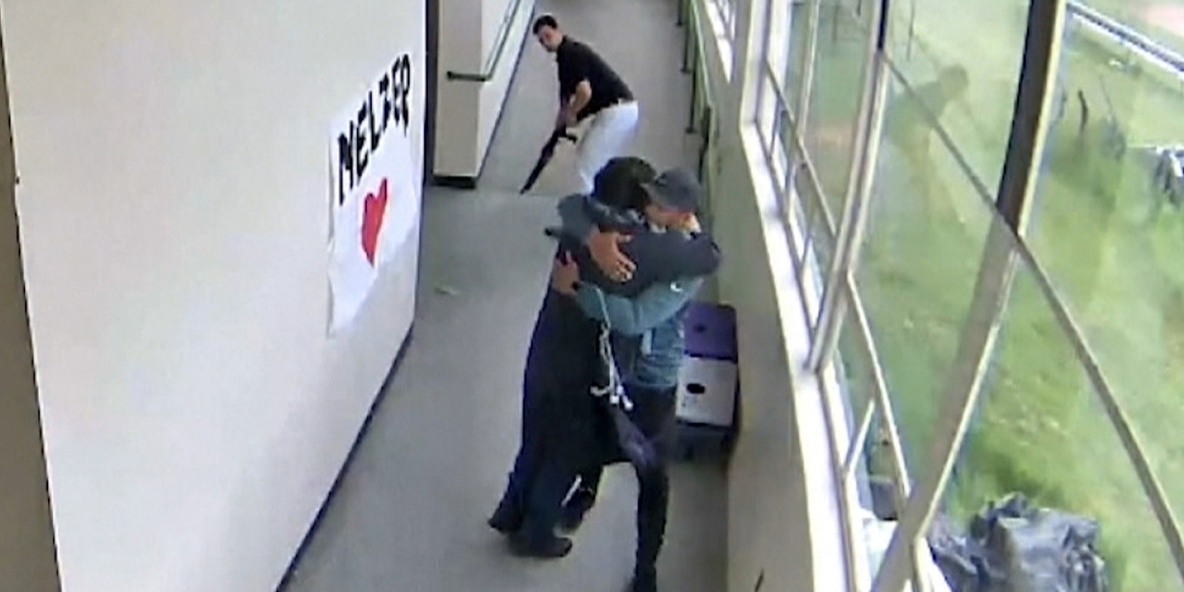 New video shows the moment Oregon coach disarmed and hugged gun-wielding student