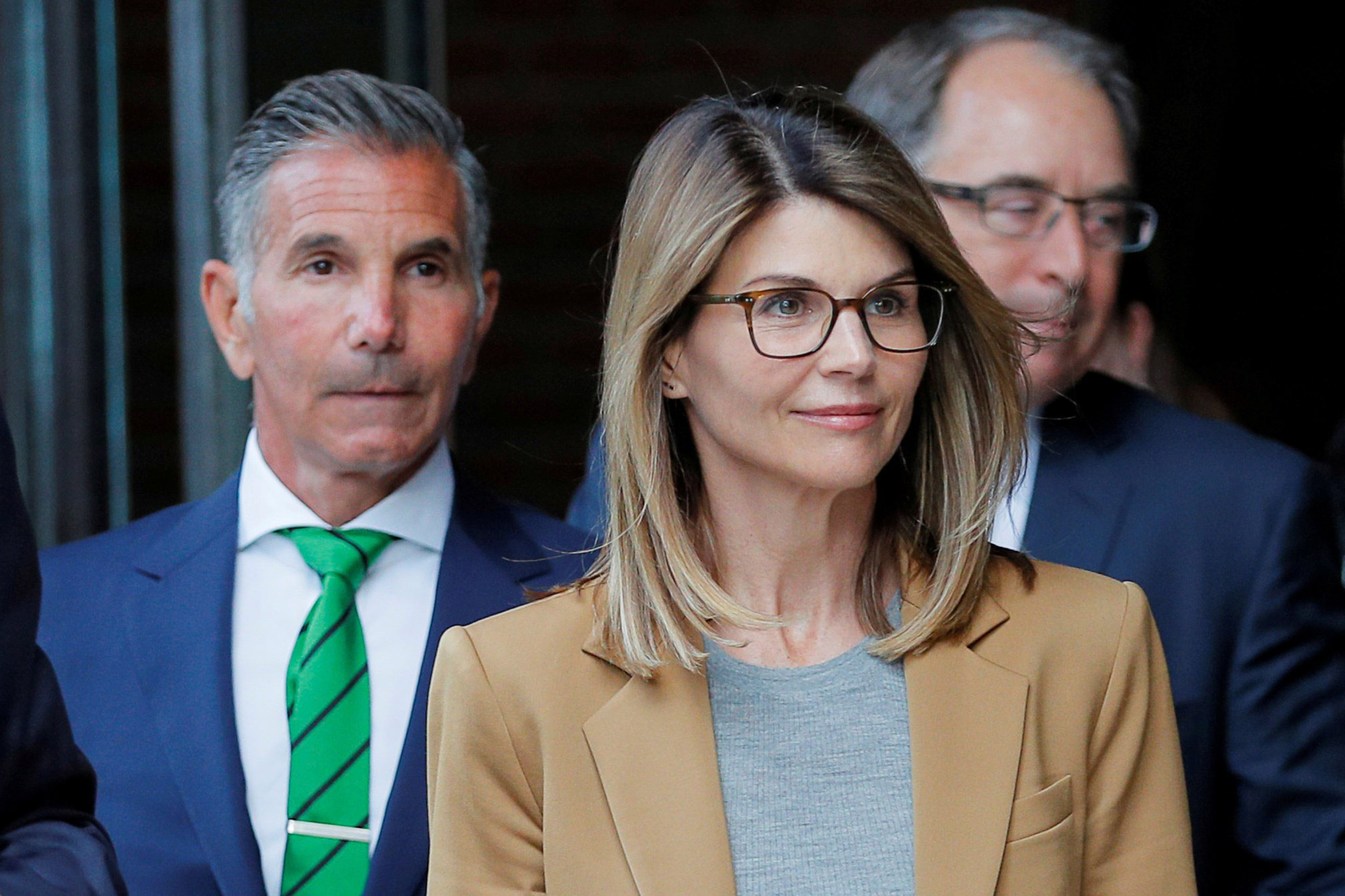 Lori Loughlin sentenced to 2 months, husband to 5 months, in ...