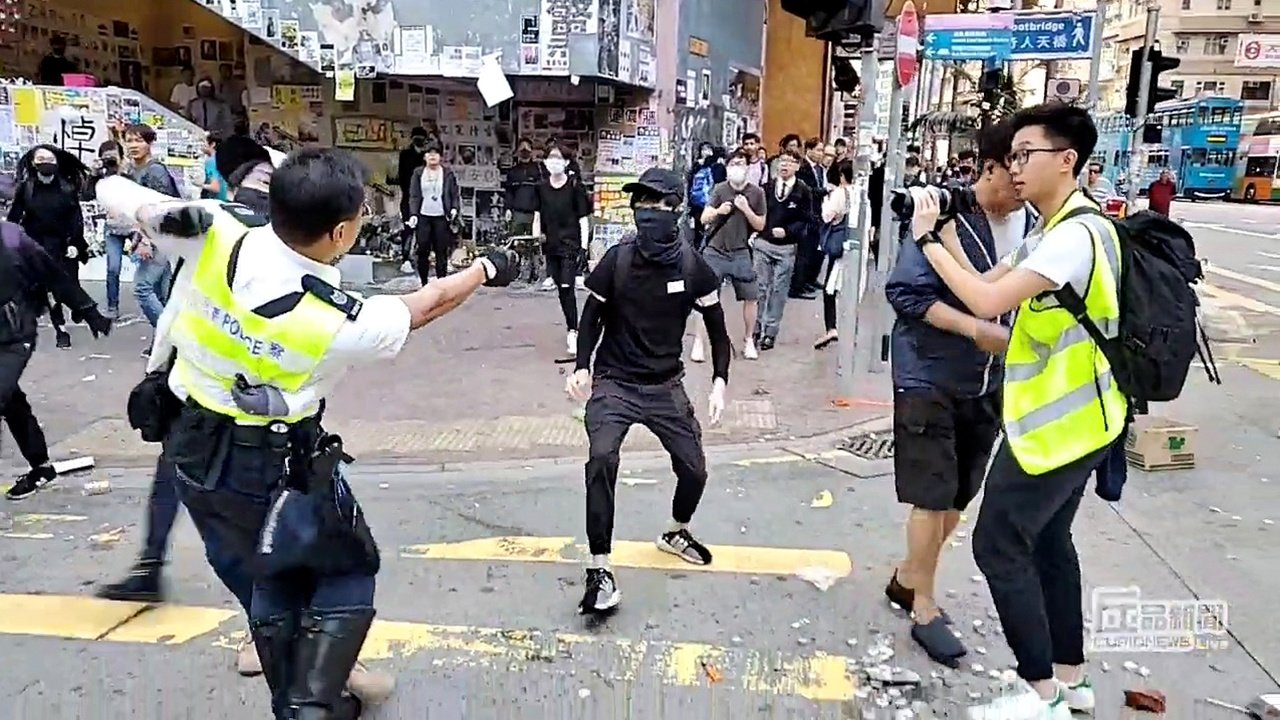 Hong Kong police shoot, critically wound protester