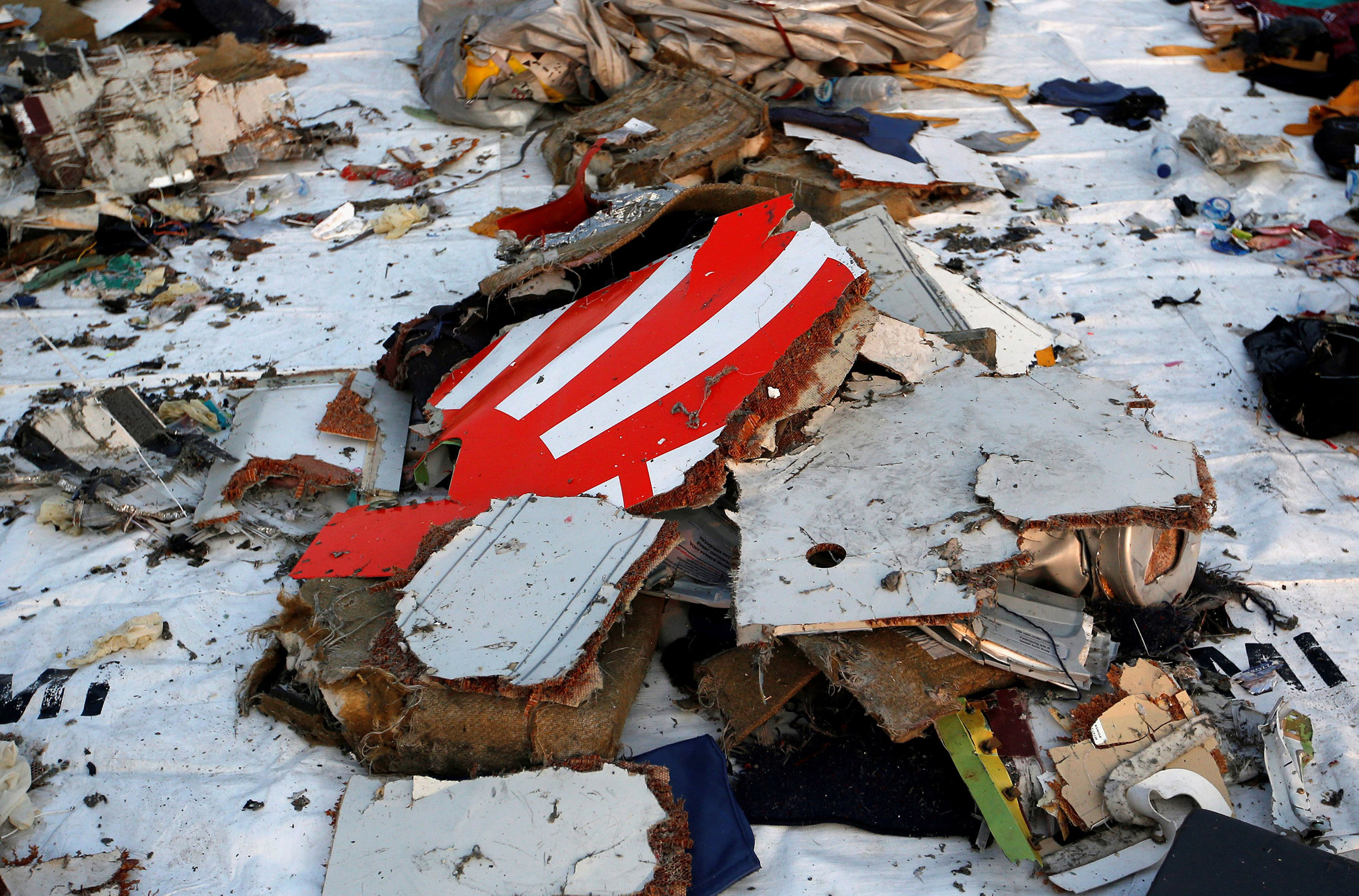 Image: Wreckage recovered from Lion Air flight JT610 that crashed into the sea lies at Tanjung Priok port in Jakarta, Indonesia
