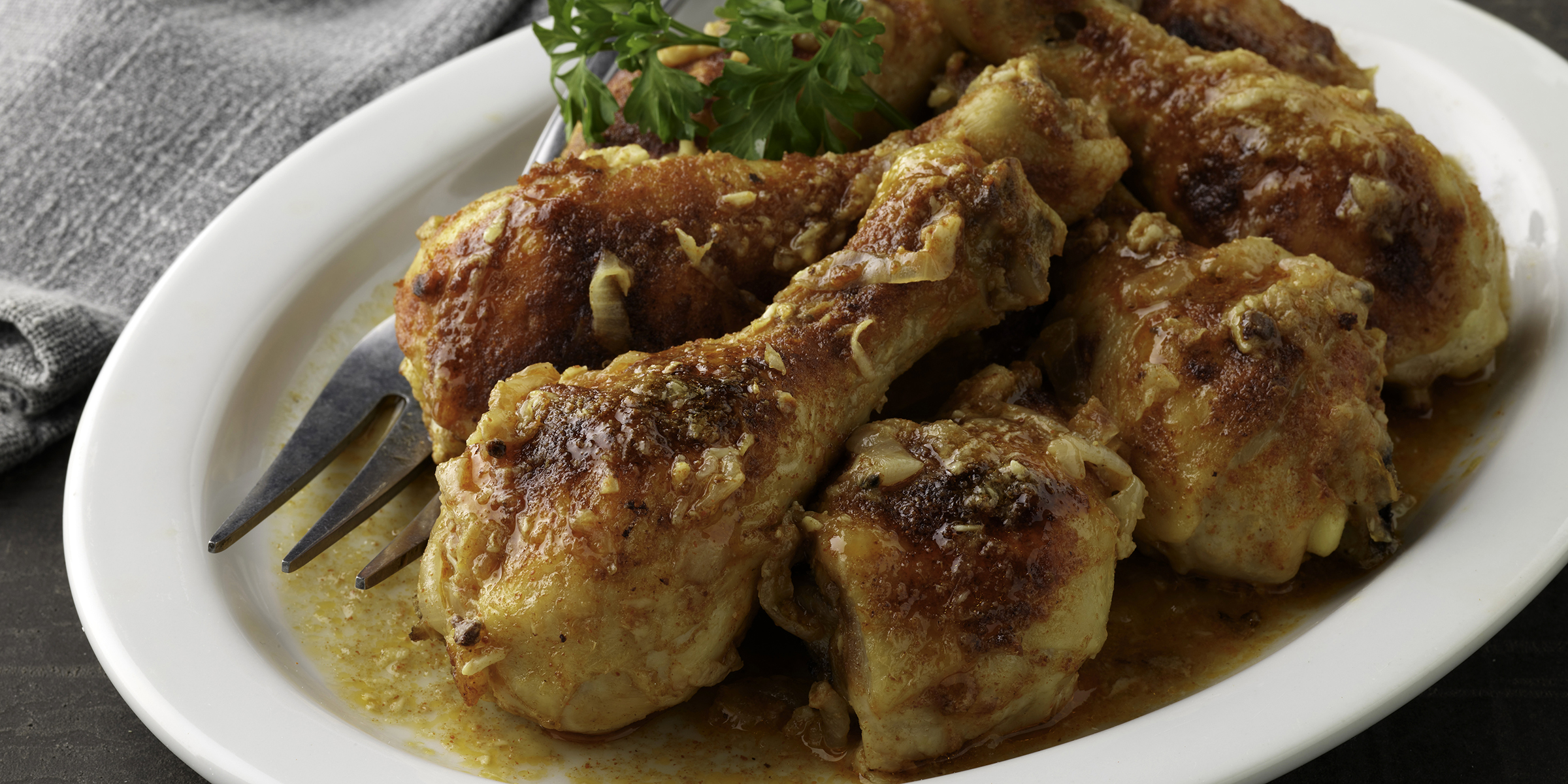 Carla Hall lightens up Southern-style smothered chicken by cooking it in the oven