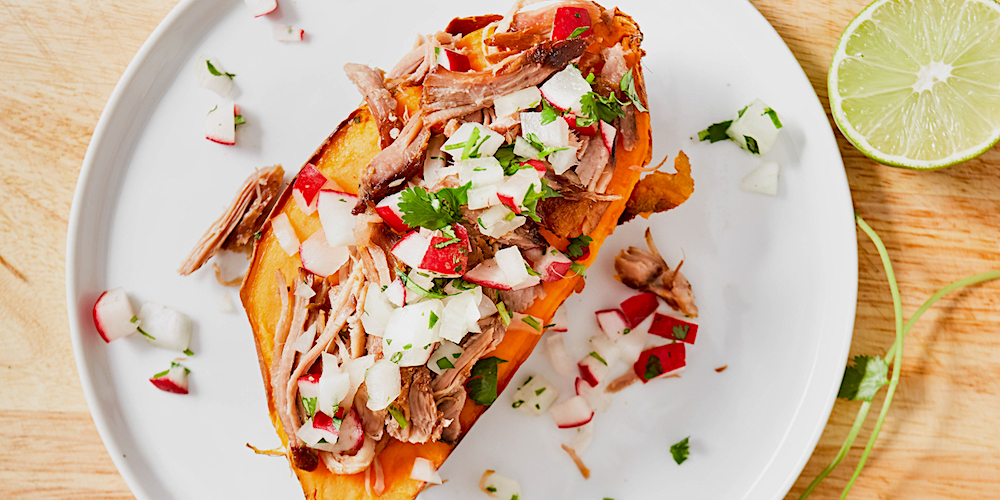 Top roasted sweet potatoes with pulled pork and homemade salsa