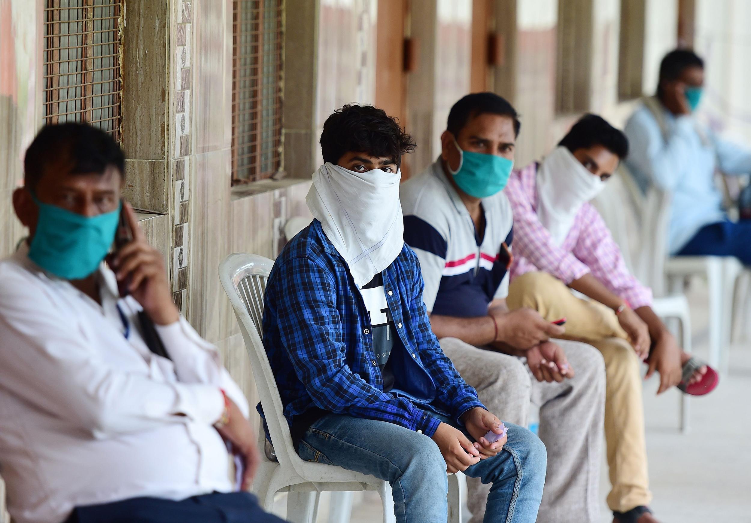 Coronavirus: India hits 2 million cases as health volunteers go on strike