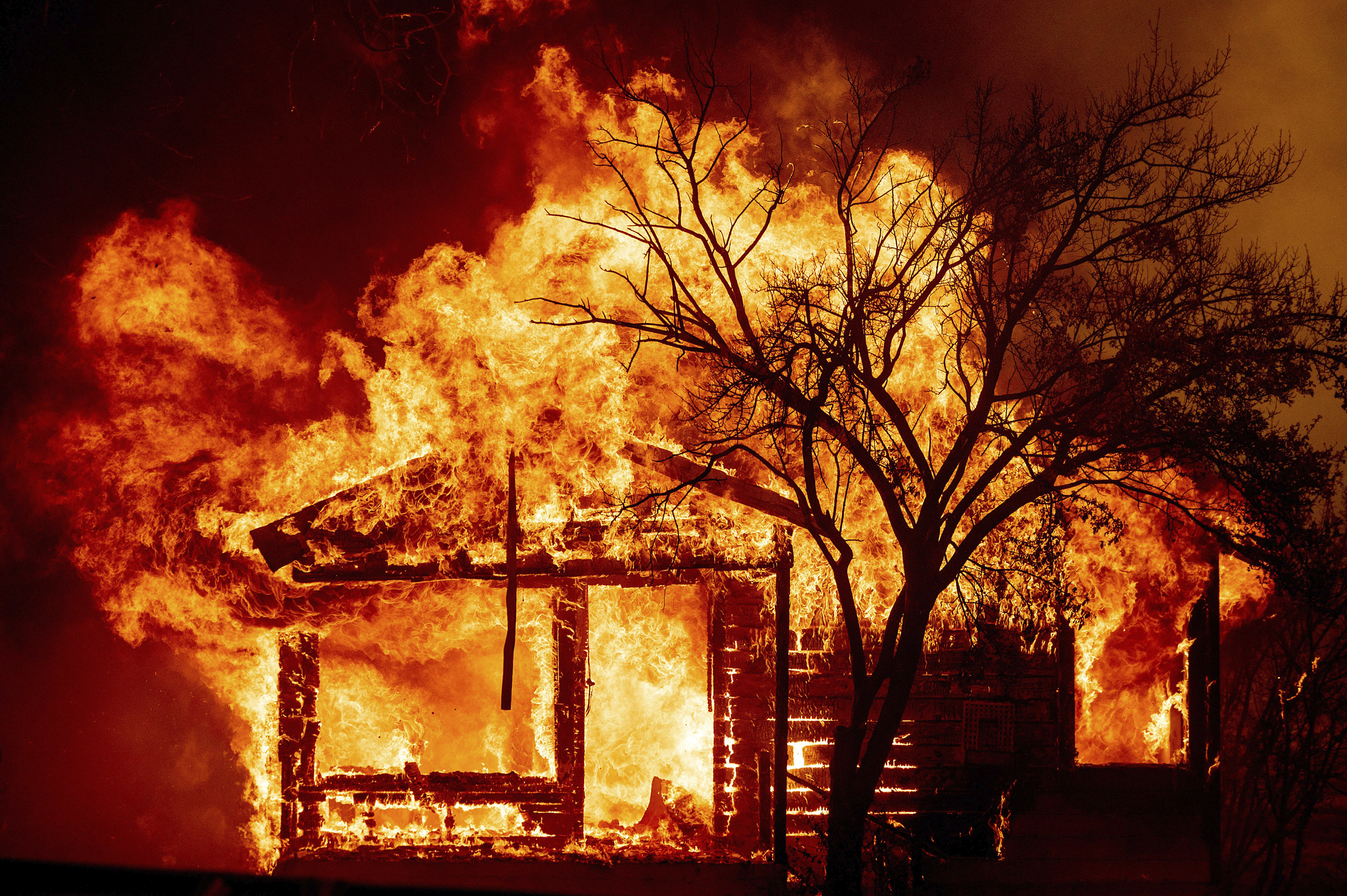 At least 5 dead in California fires; tens of thousands forced to flee