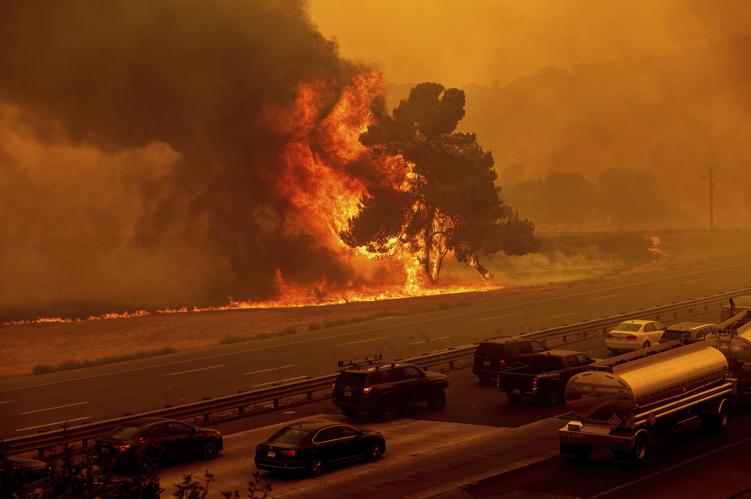 Firefighters are stretched thin as flames rage across California