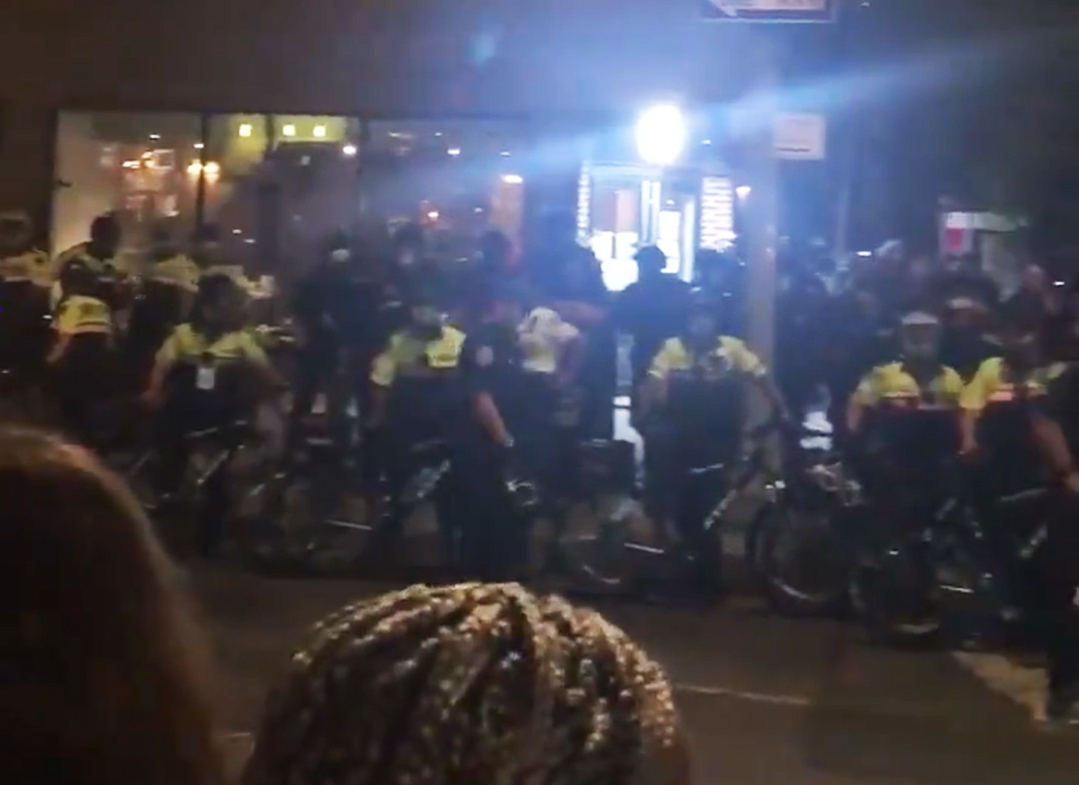 Police officers with bicycles stand near the corner of Hudson and West 10th streets in New York City on Sept. 26, 2020. (Molly Dillon via Twitter)