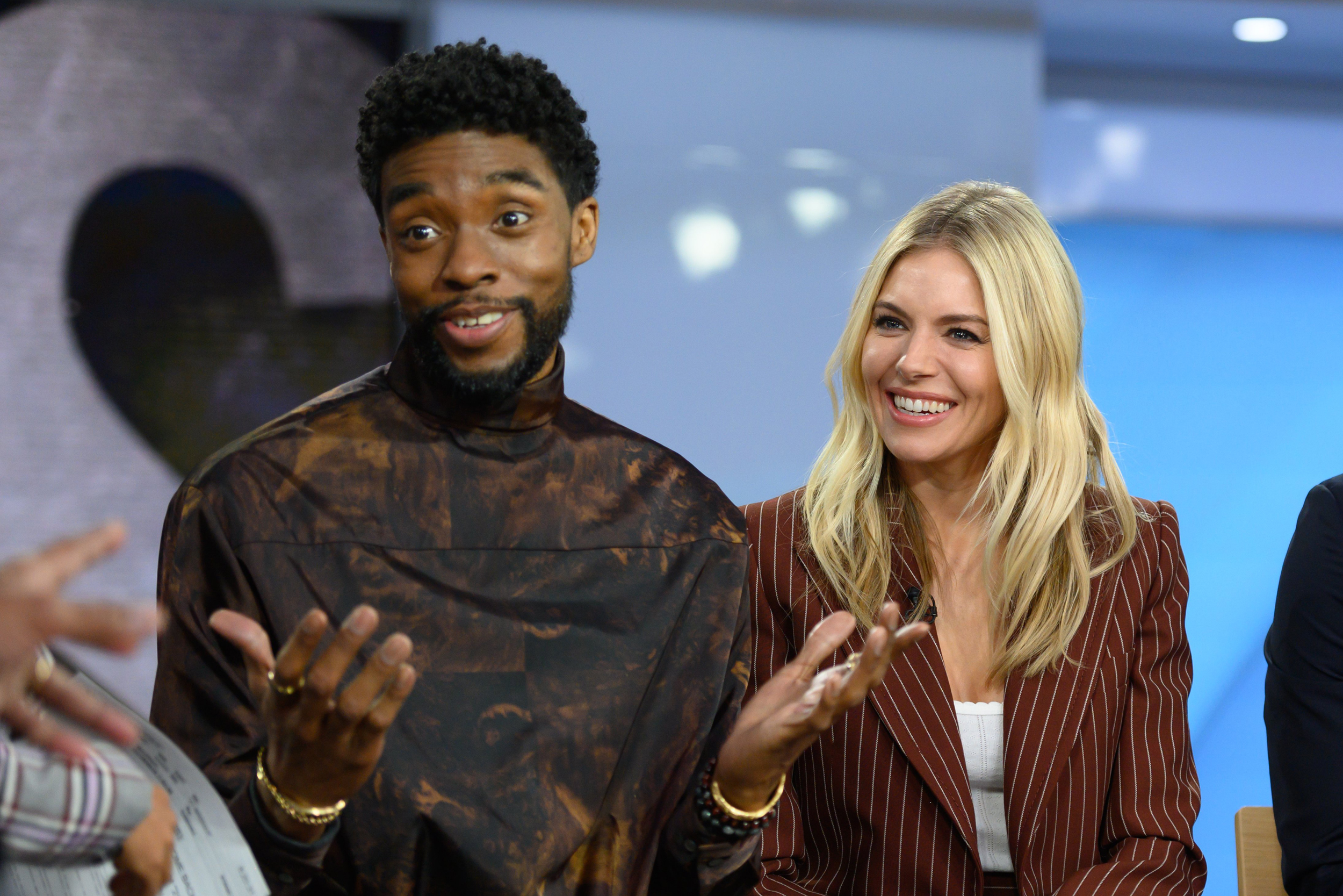 Chadwick Boseman took pay cut to boost Sienna Miller's salary on '21 Bridges'