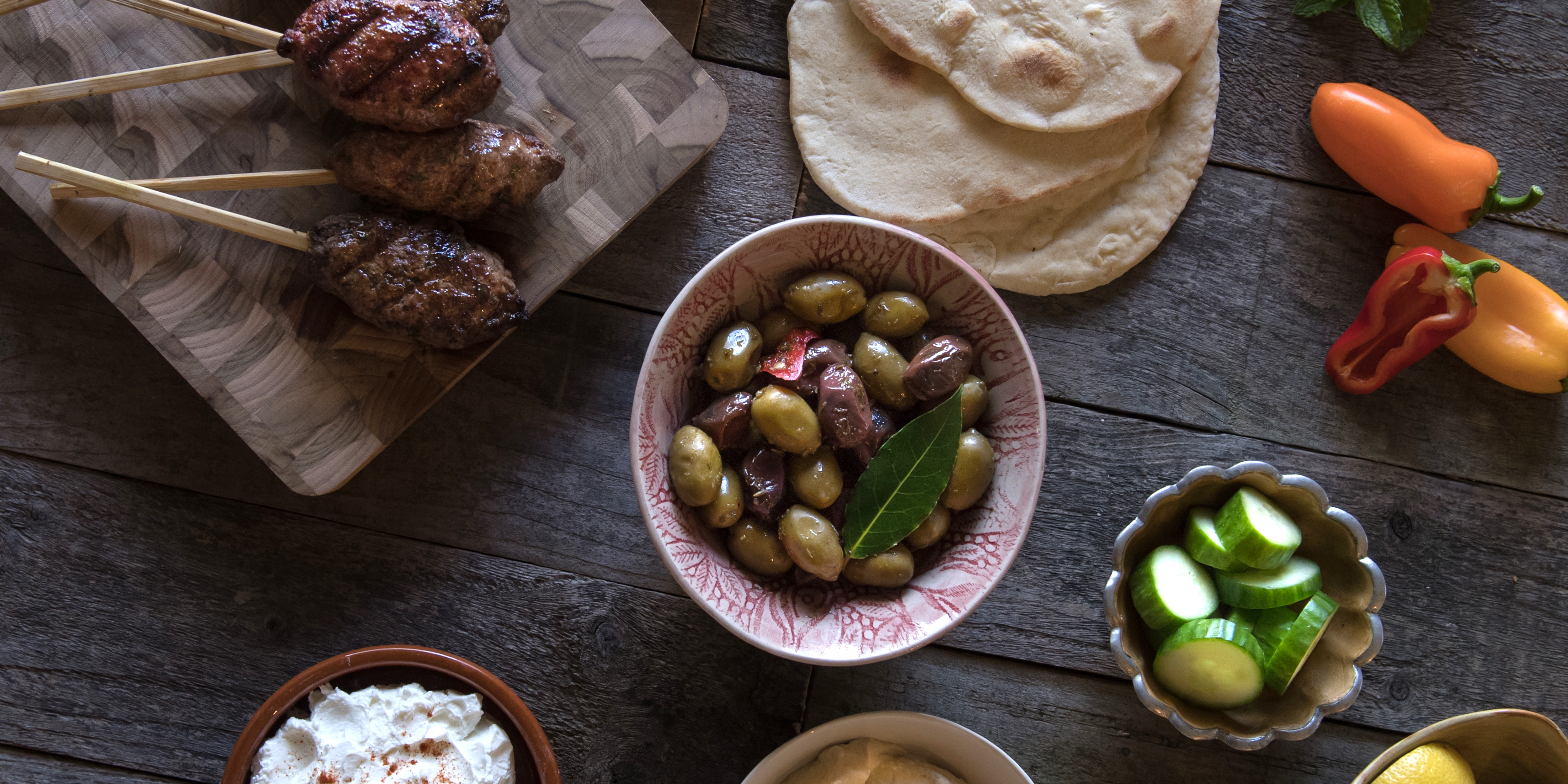 Wrap grilled kofta in fluffy pita with creamy hummus and Mediterranean salad