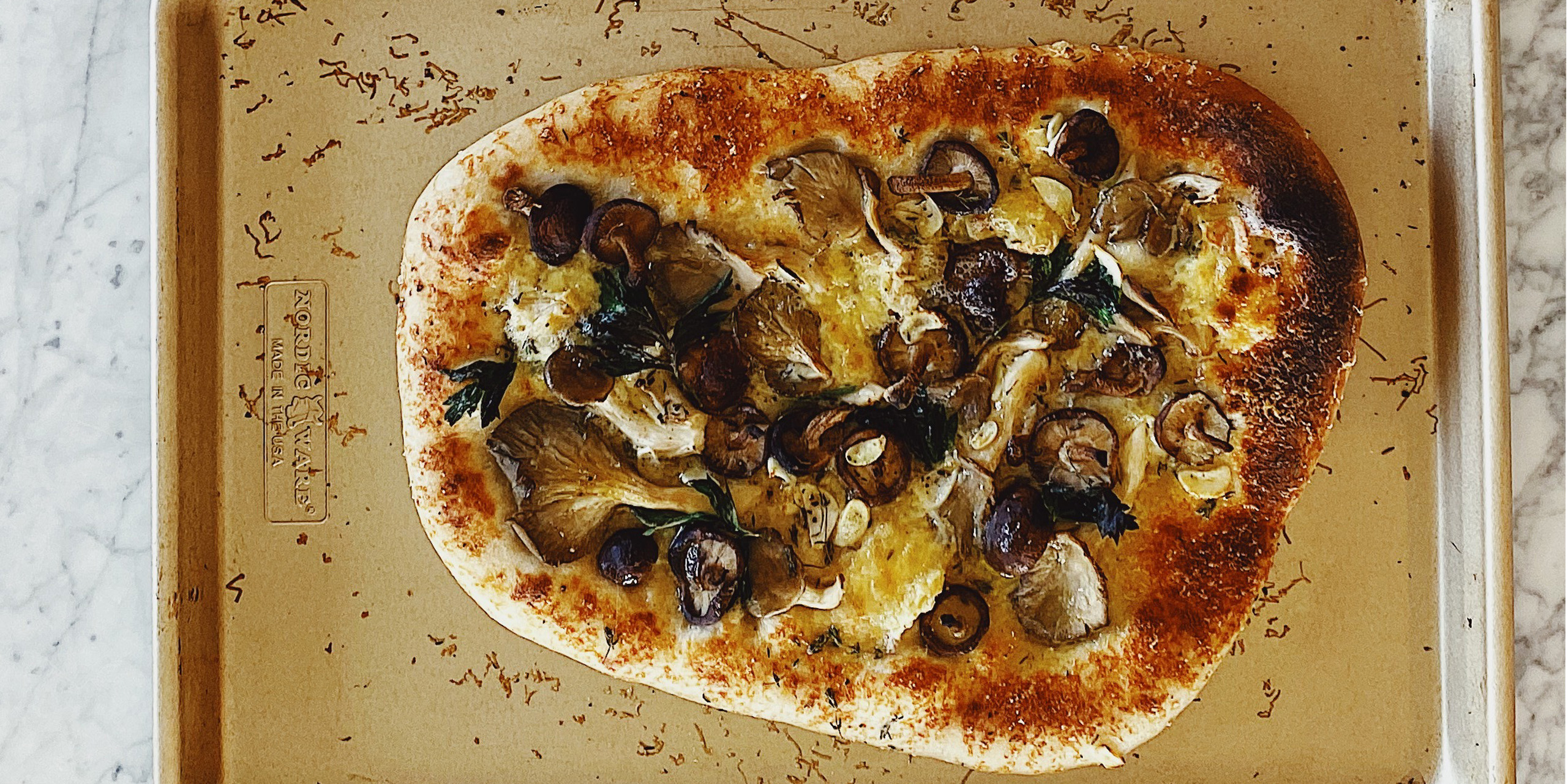 Make Chef Gabe Bertaccini's homemade Italian pizza on a sheet pan