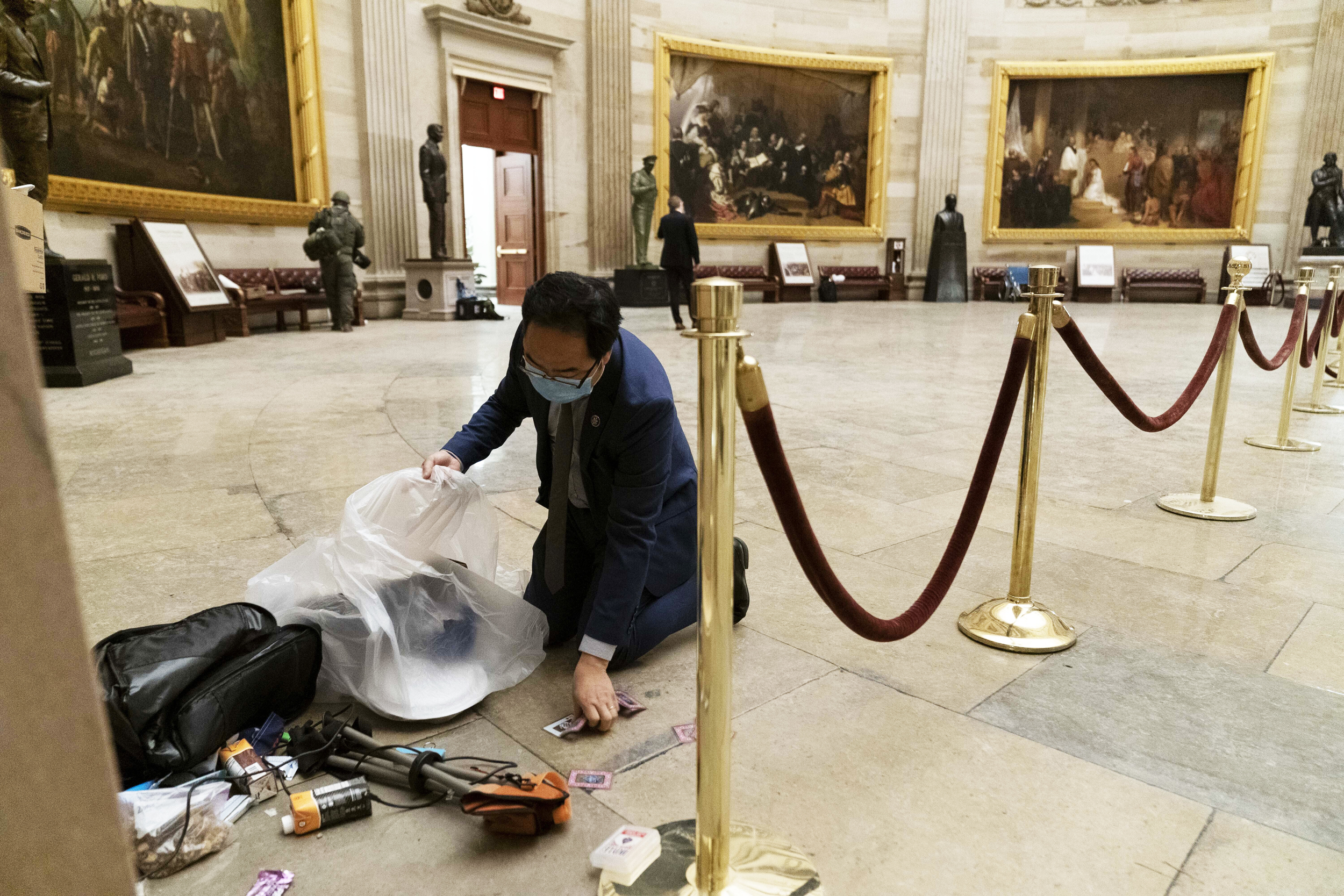 Behind the viral photo of Rep. Andy Kim cleaning up at midnight after riots