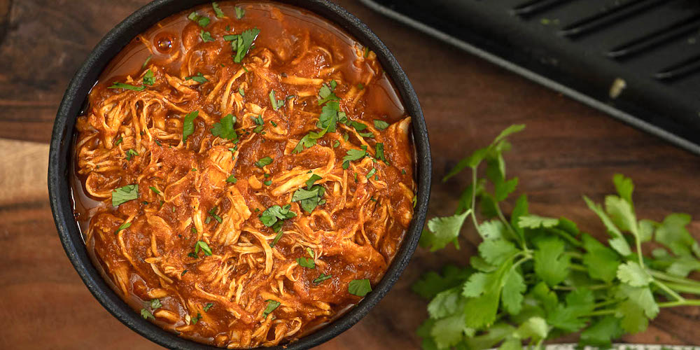 Make spicy, smoky, tender chicken tinga in the slow cooker