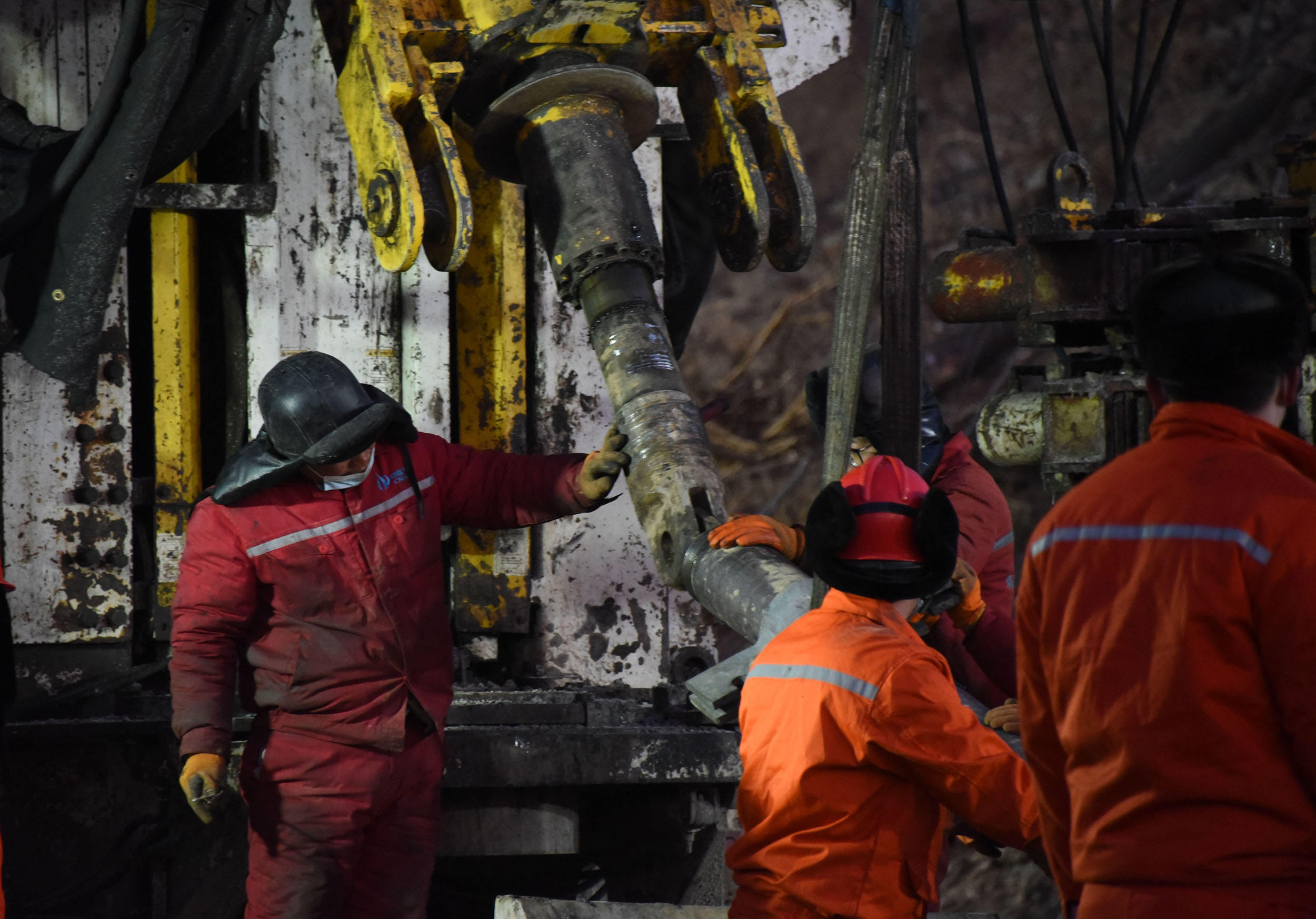 'Please don't stop the rescue': Crews race to save trapped miners in China