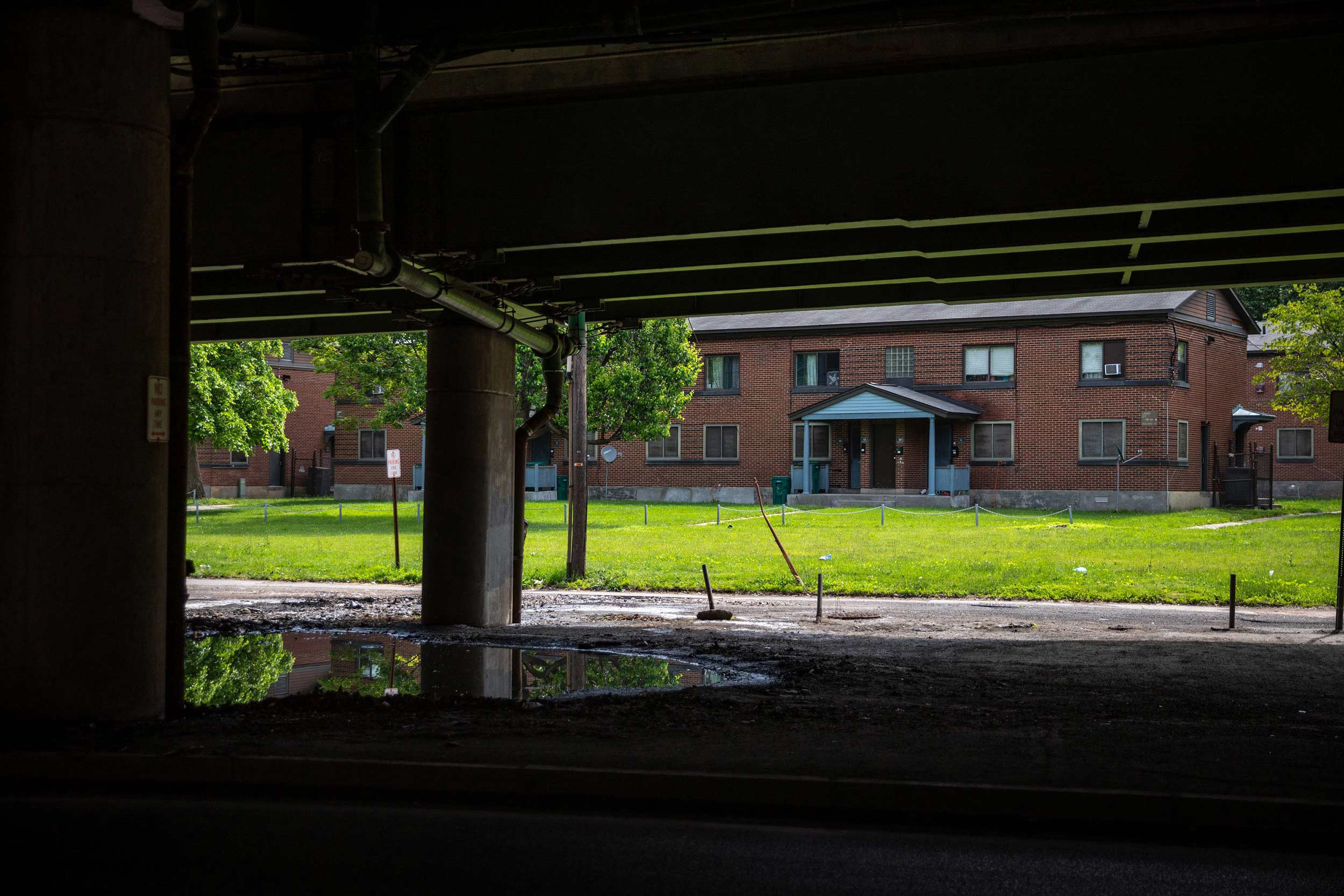 View from under the viaduct of the Pioneer Homes apartments that sit next to I-81 in Syracuse.
