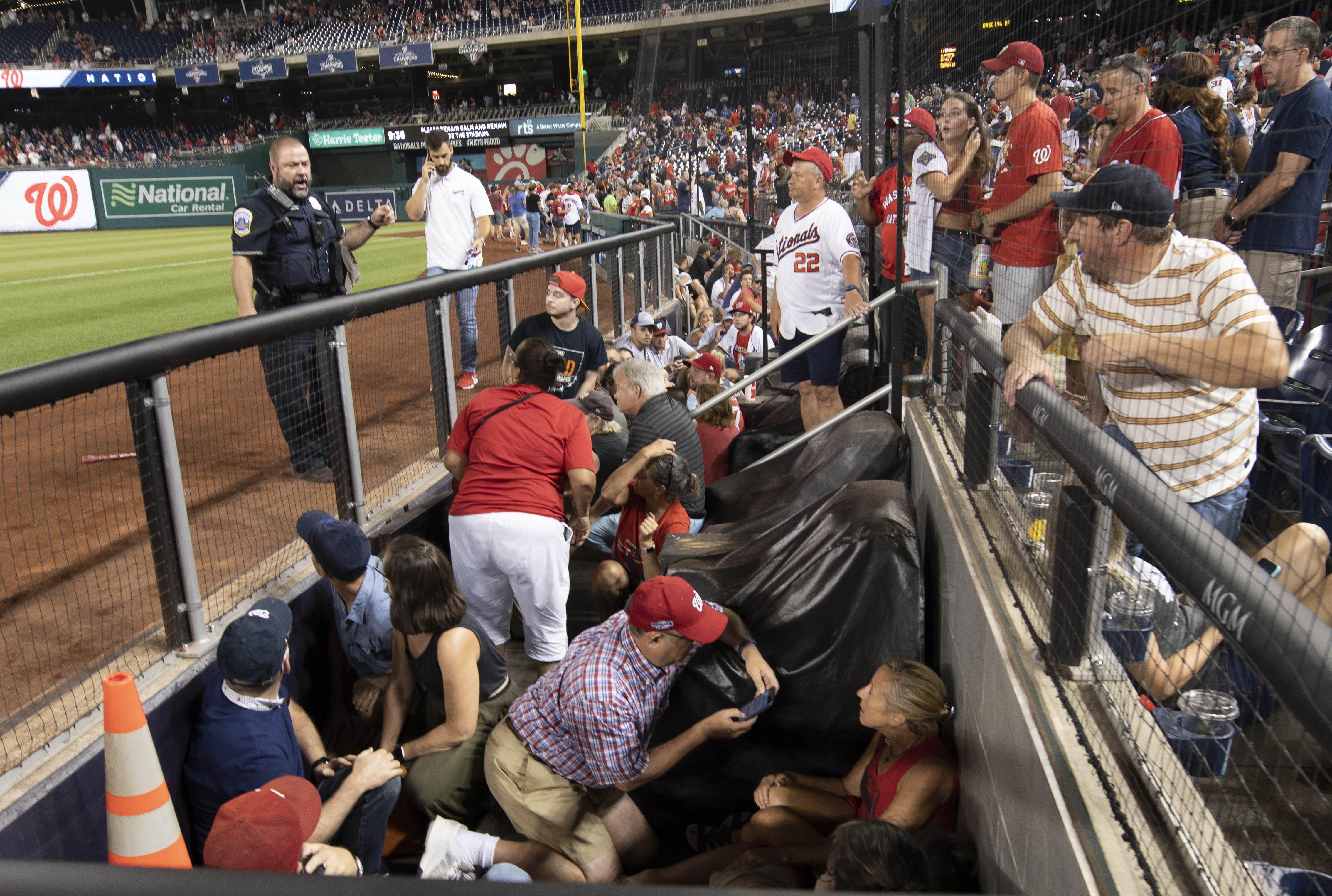 Nationals fans flee for safety after gunfire erupts outside park