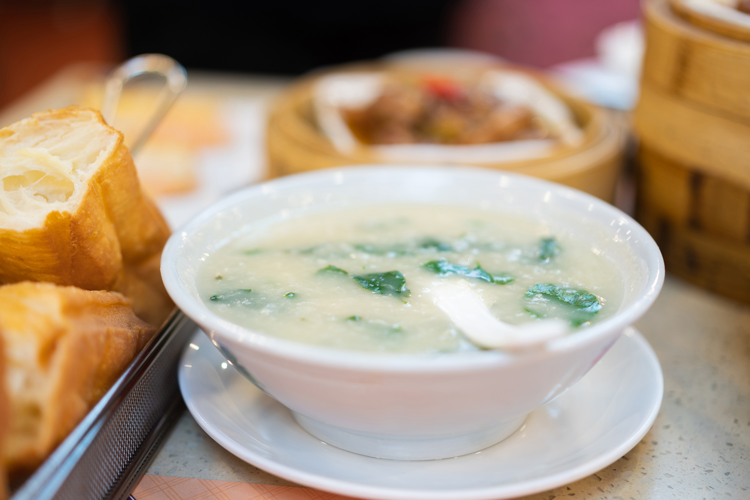 White woman making 'improved' congee apologizes
