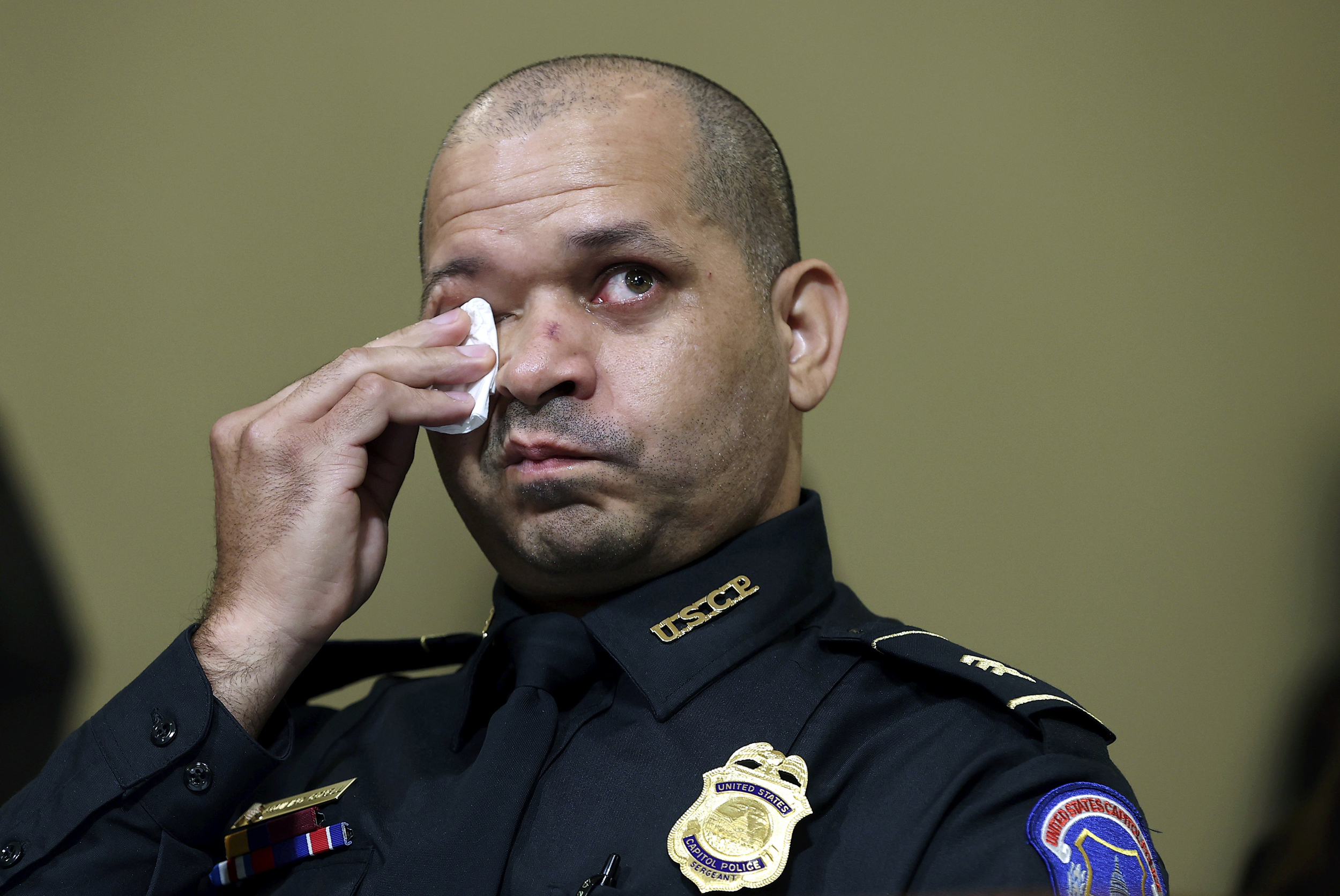 'Kill him with his own gun': Officers recount trauma of Capitol riot in emotional testimony
