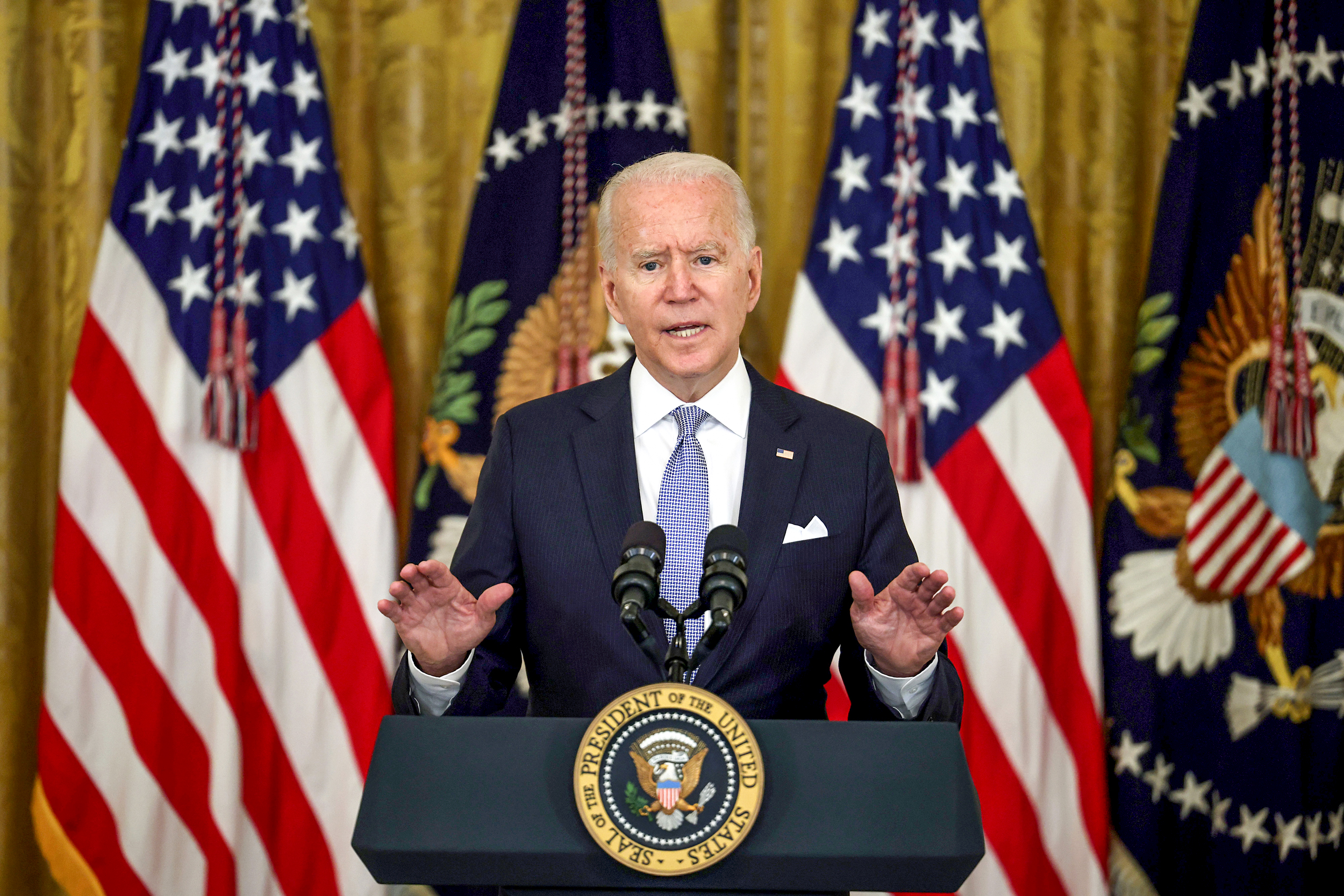 Biden says federal workers must get vaccinated or face testing, urges $100 payments