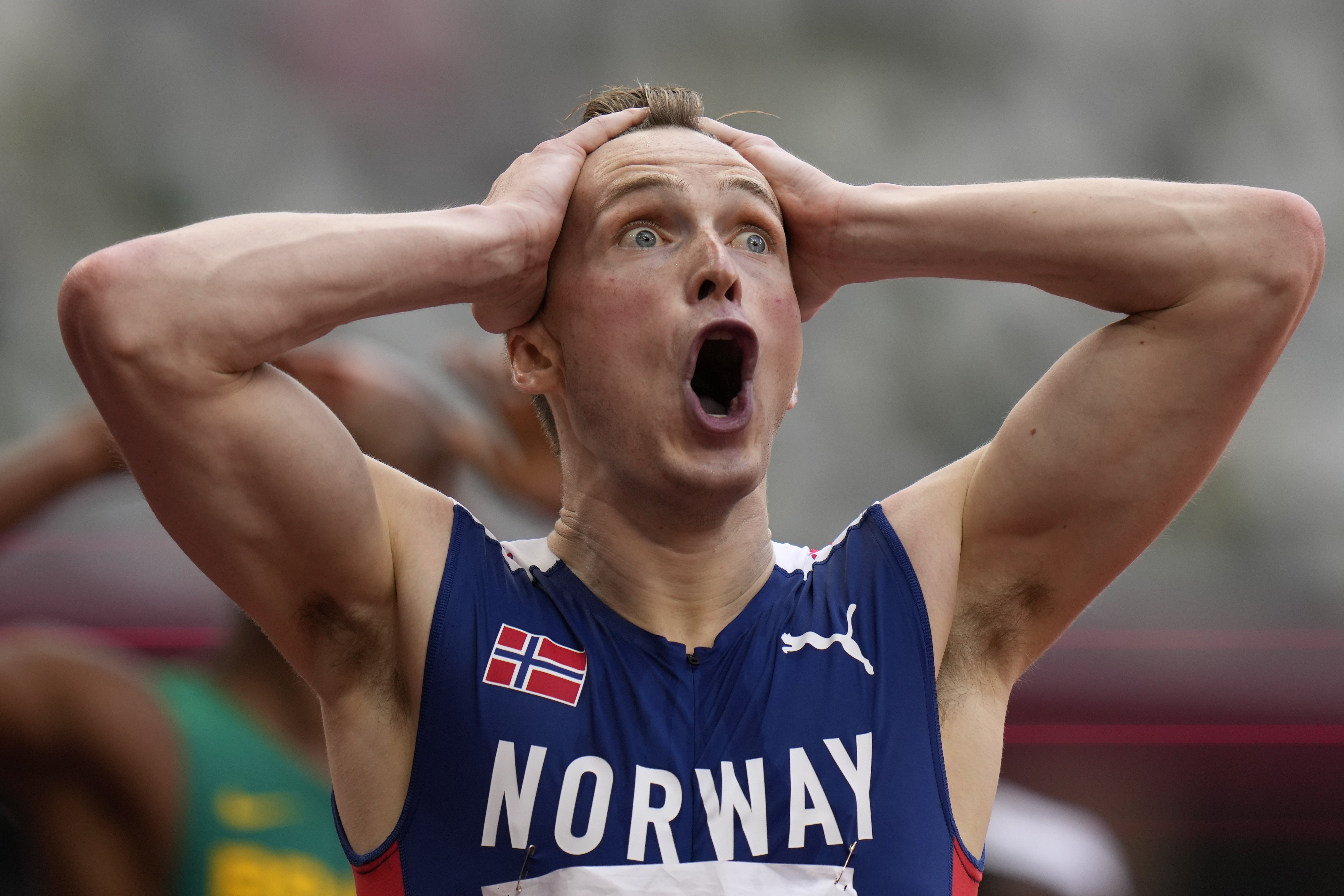 Norway's Warholm crushes world record in hurdles showdown for the ages