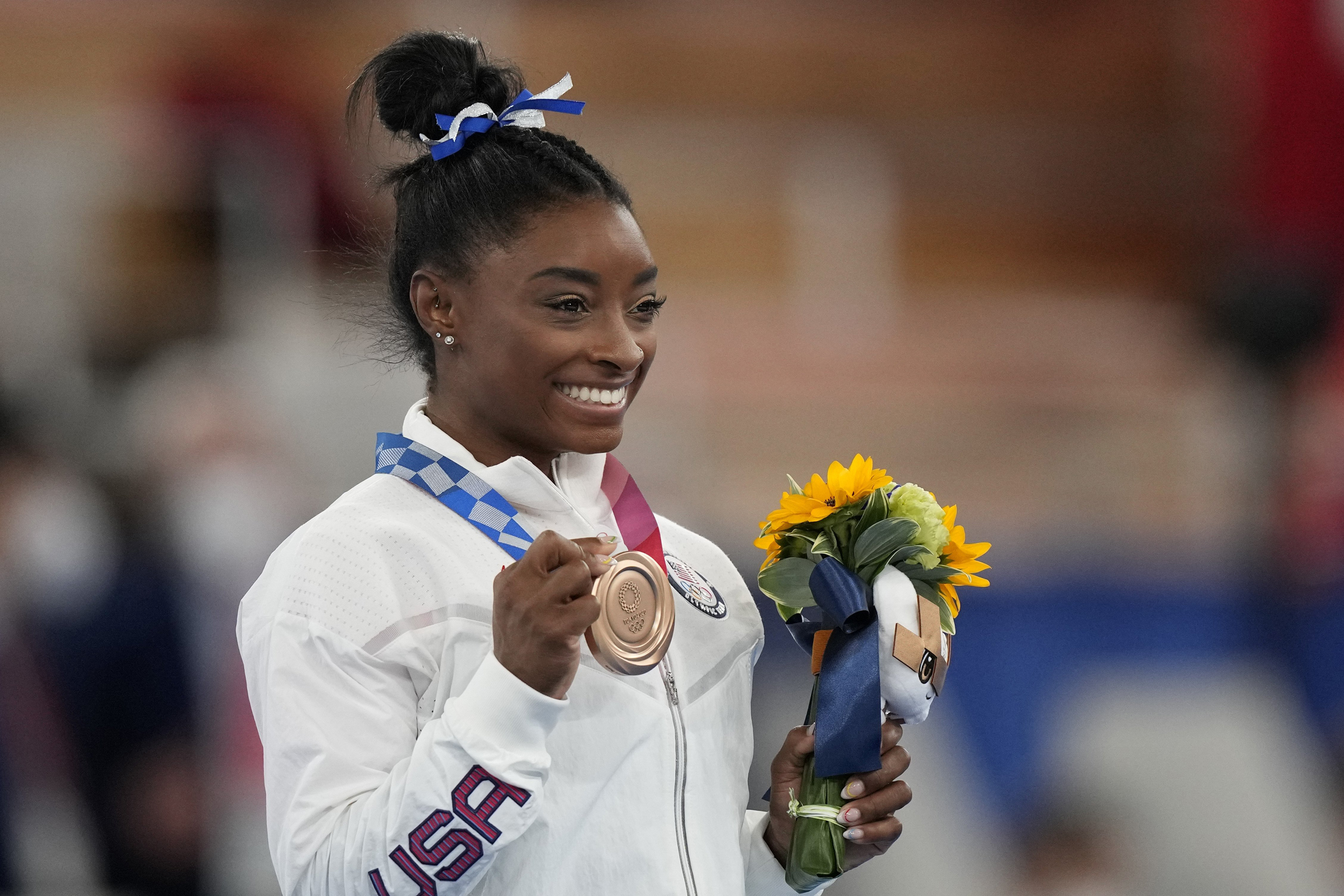Simone Biles wins bronze on balance beam in Olympic return