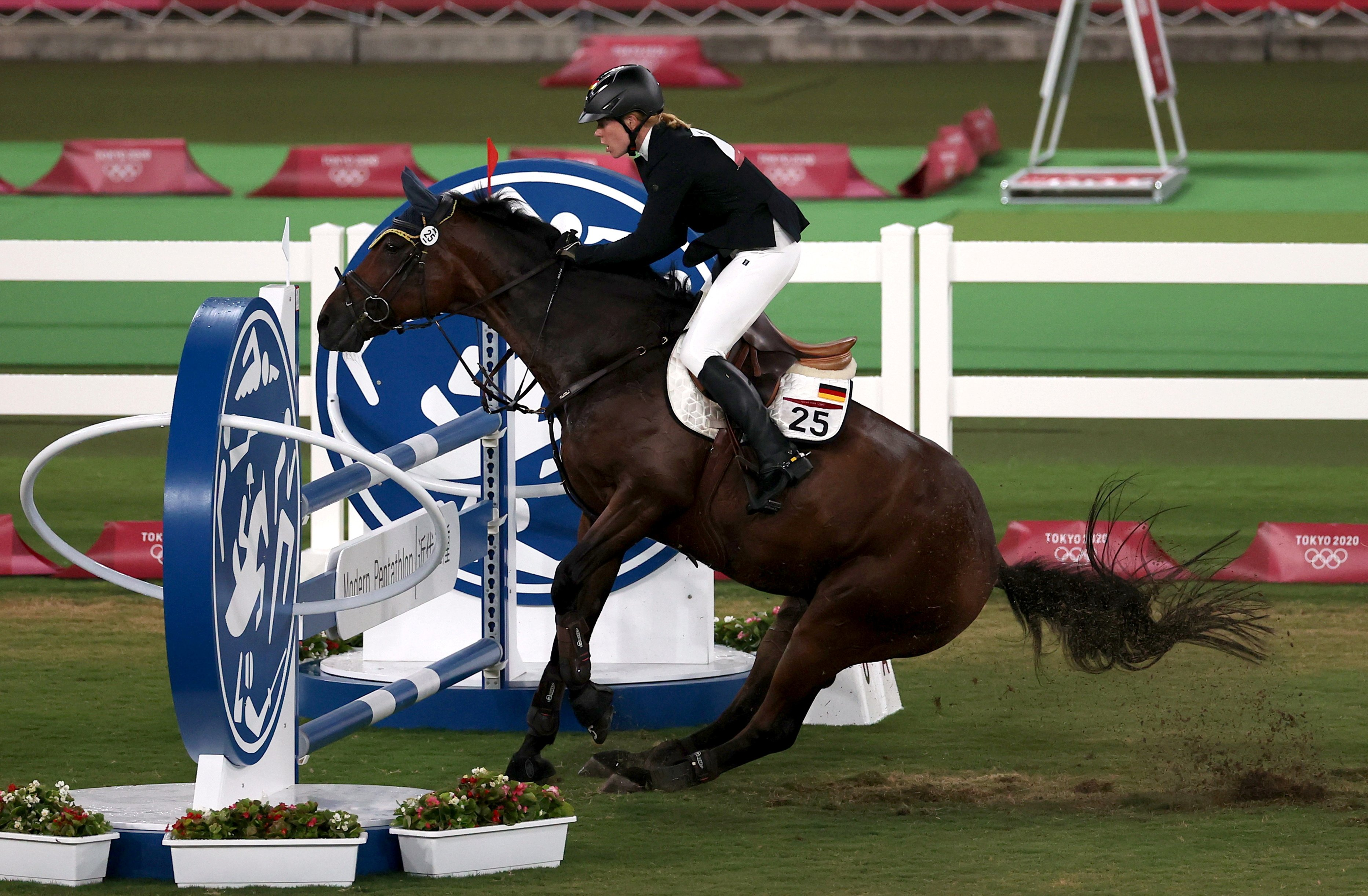 German coach kicked out of Olympics for punching horse that wouldn't jump