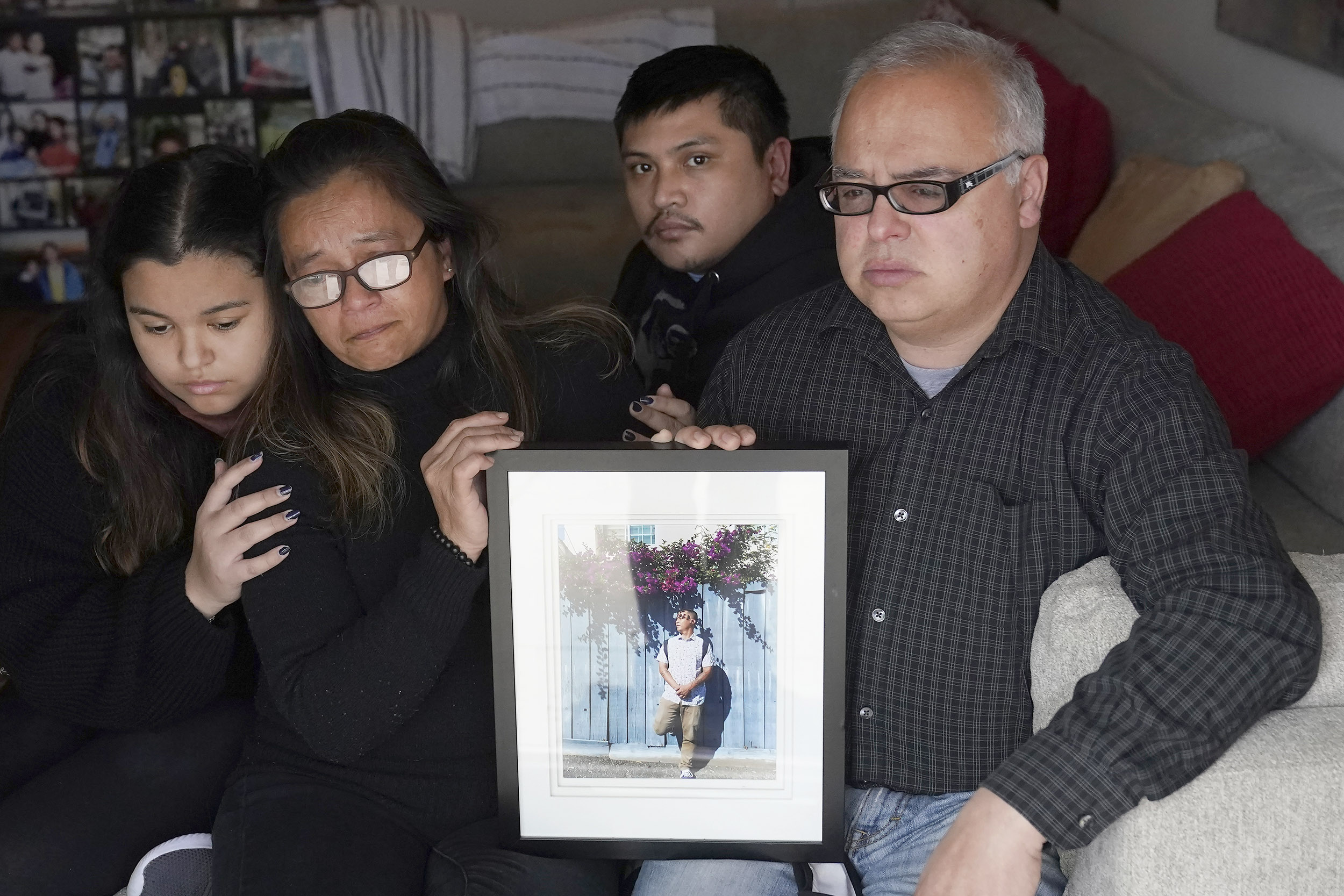 Family of man killed after police put knee to his neck sues