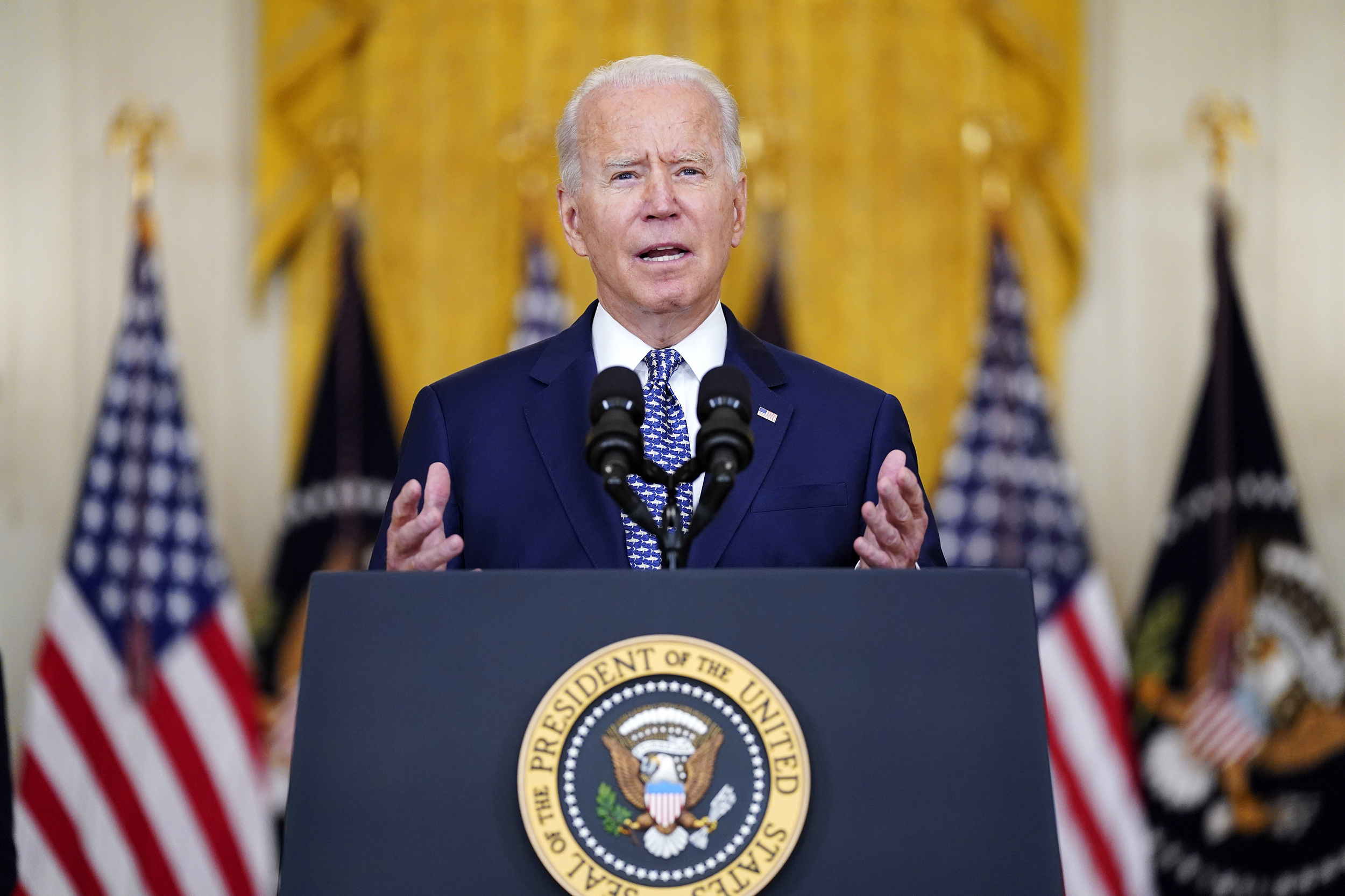 Biden celebrates a bipartisan win briefly overshadowed by Cuomo