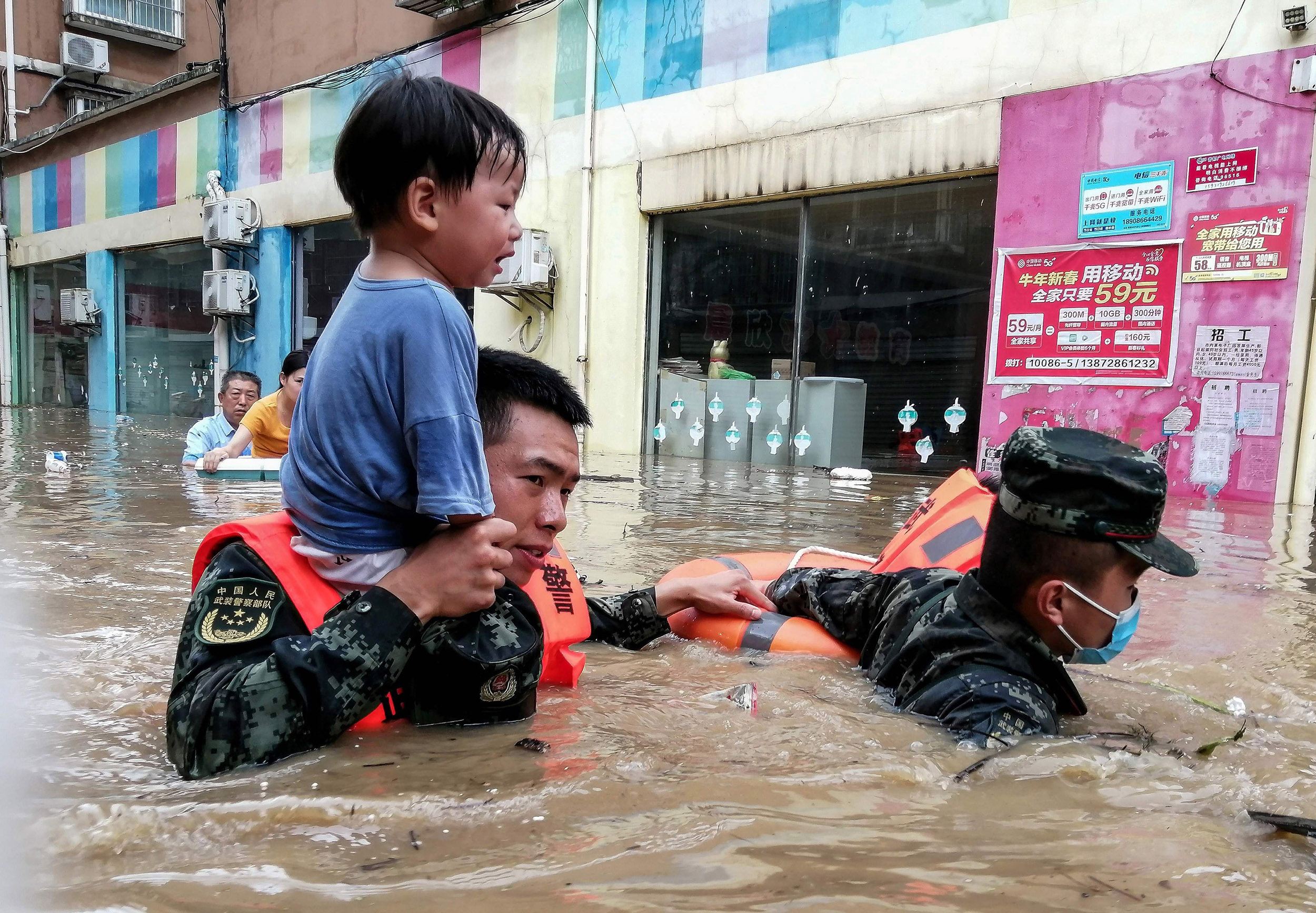 China cities declare 'red alerts' as flood death toll hits 21