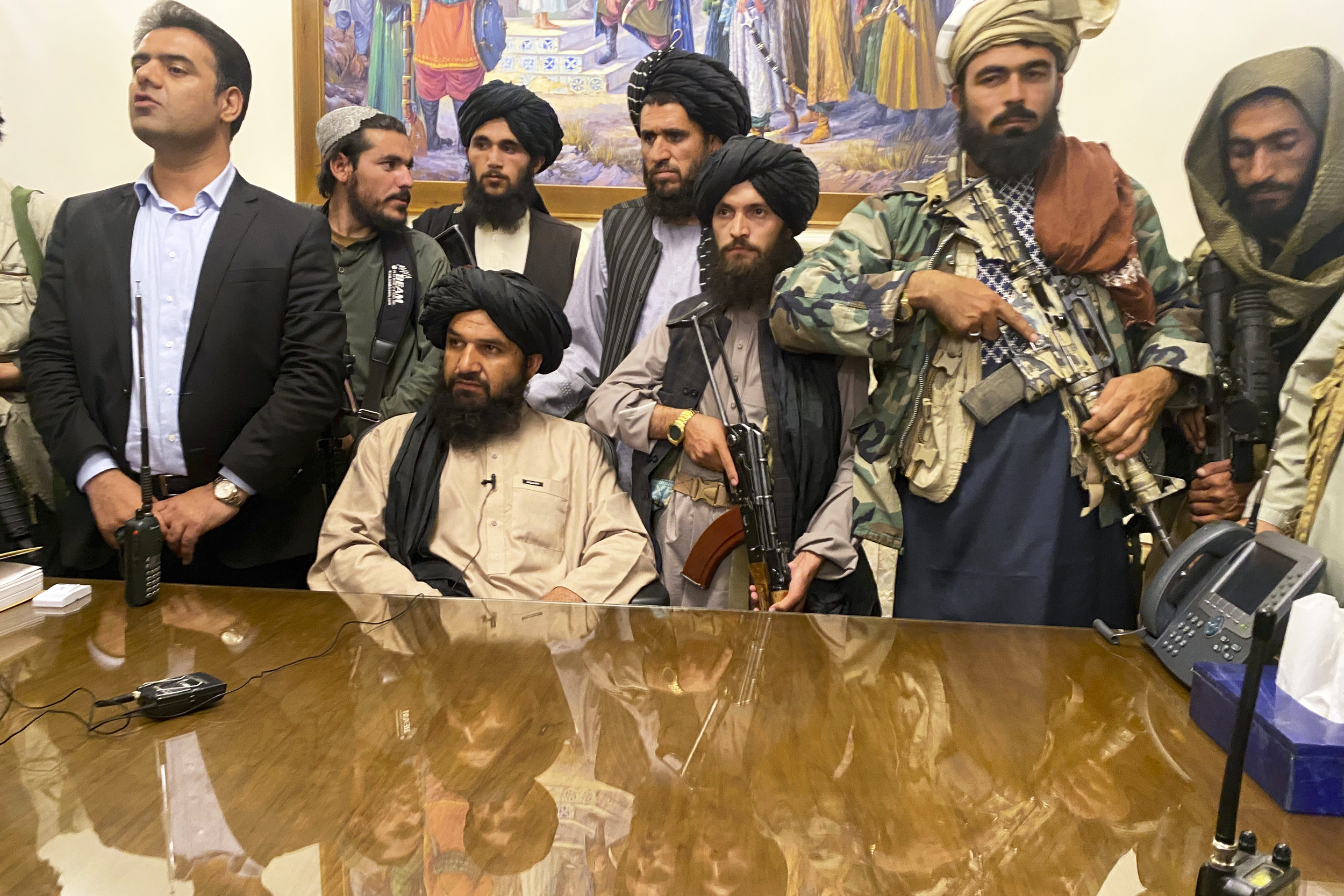 Video shows Taliban celebrating inside Afghanistan presidential palace